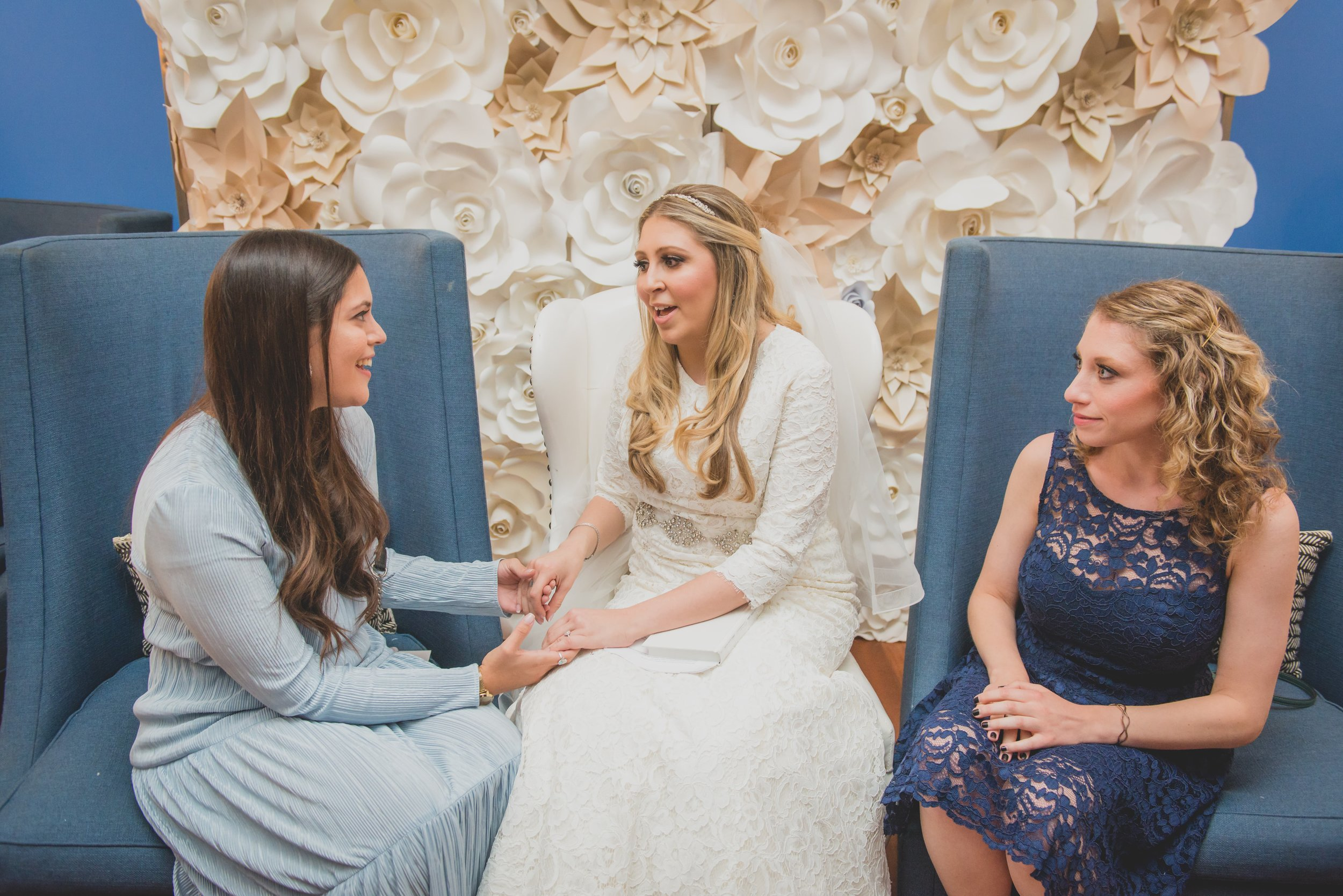 A bride greeting her guests in a lounge reception area.