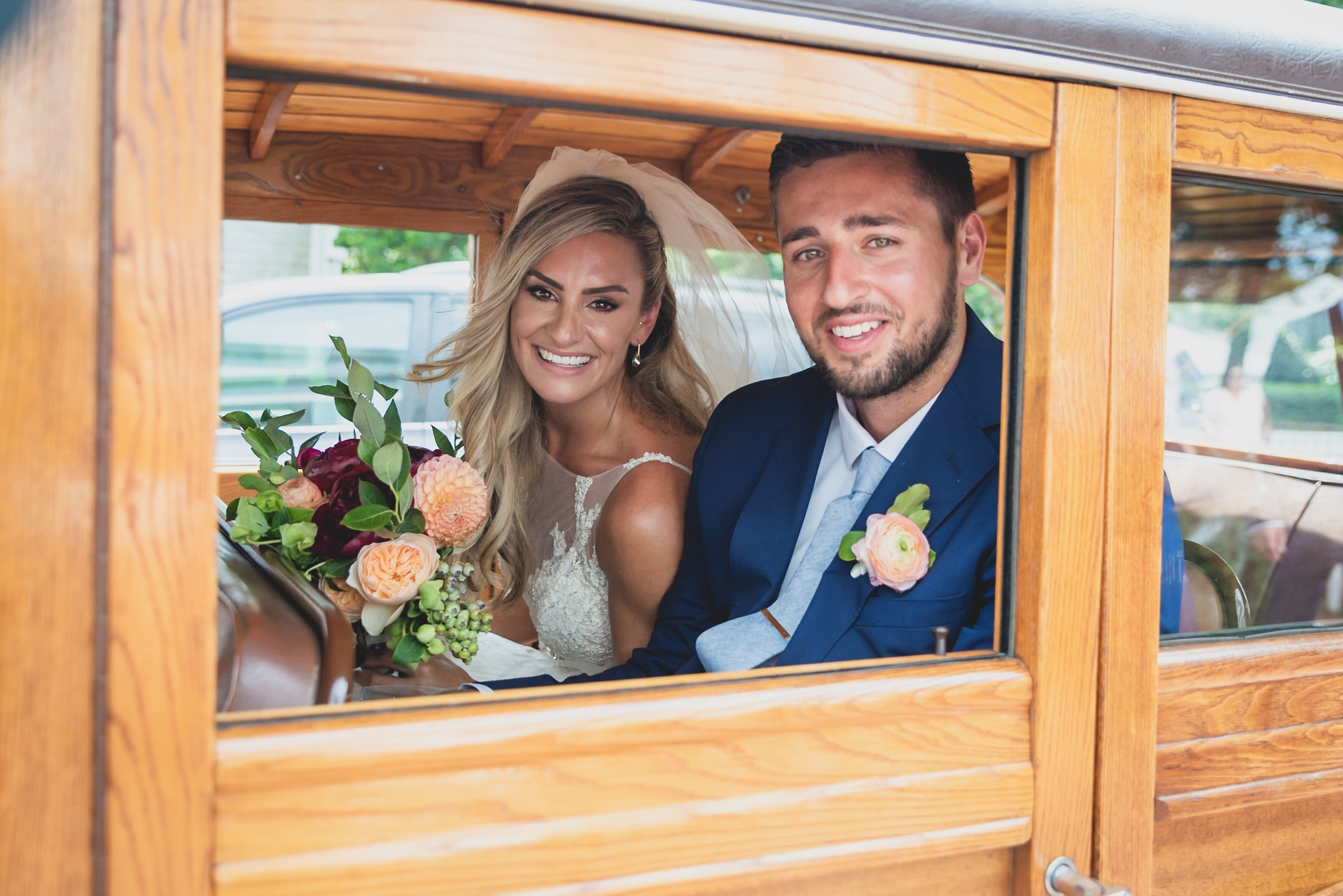 Bride and groom leaving their wedding in a wooden cart.