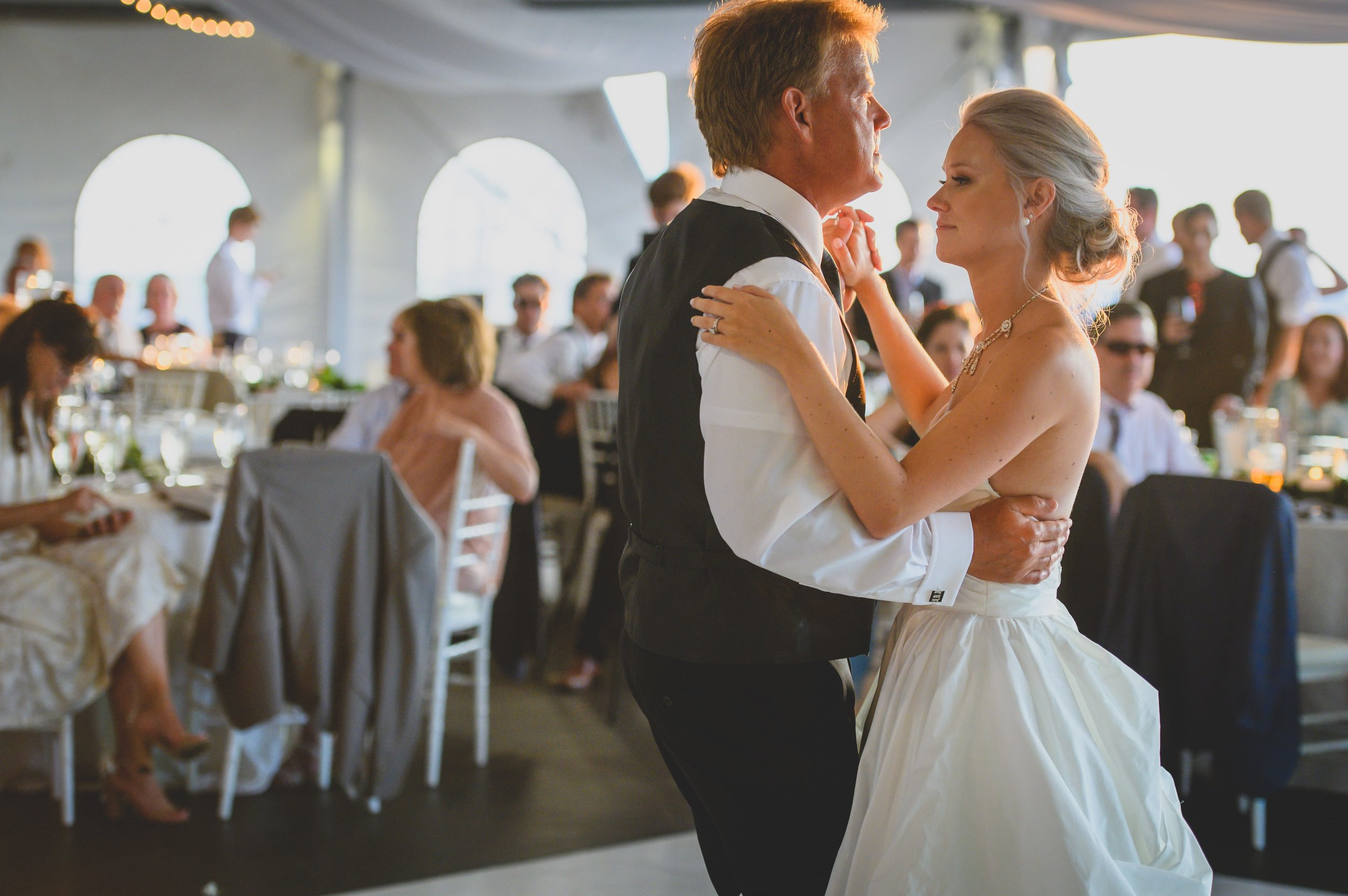 A bride and her father performing the daddy-daughter dance.