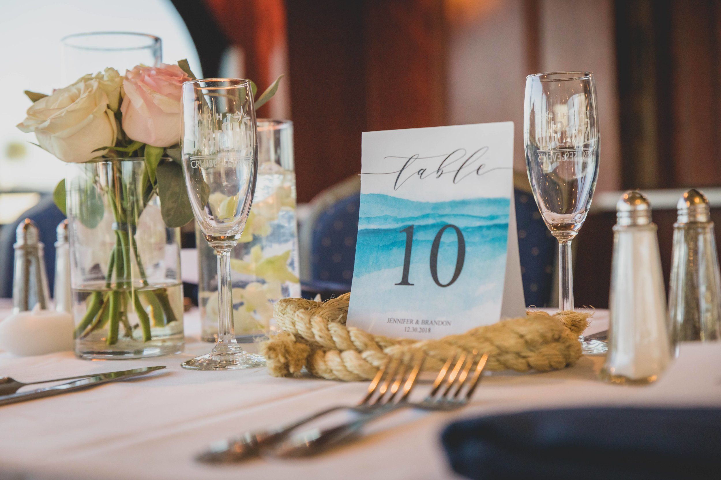 A nautical themed wedding reception table.