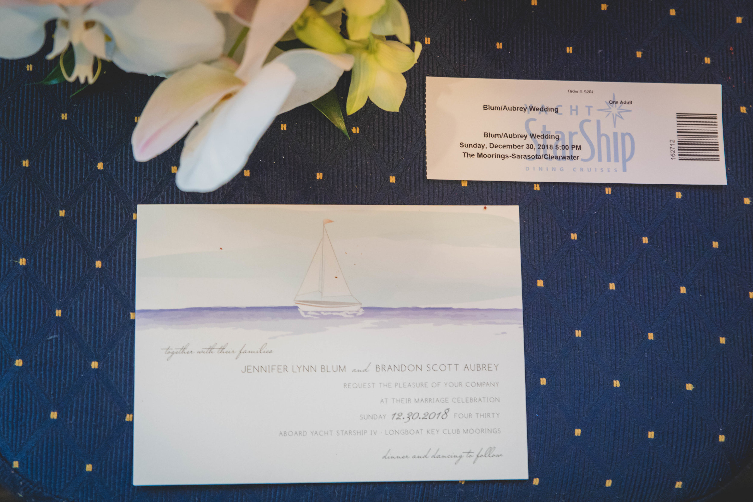 A nautical themed wedding invitation and admission ticket