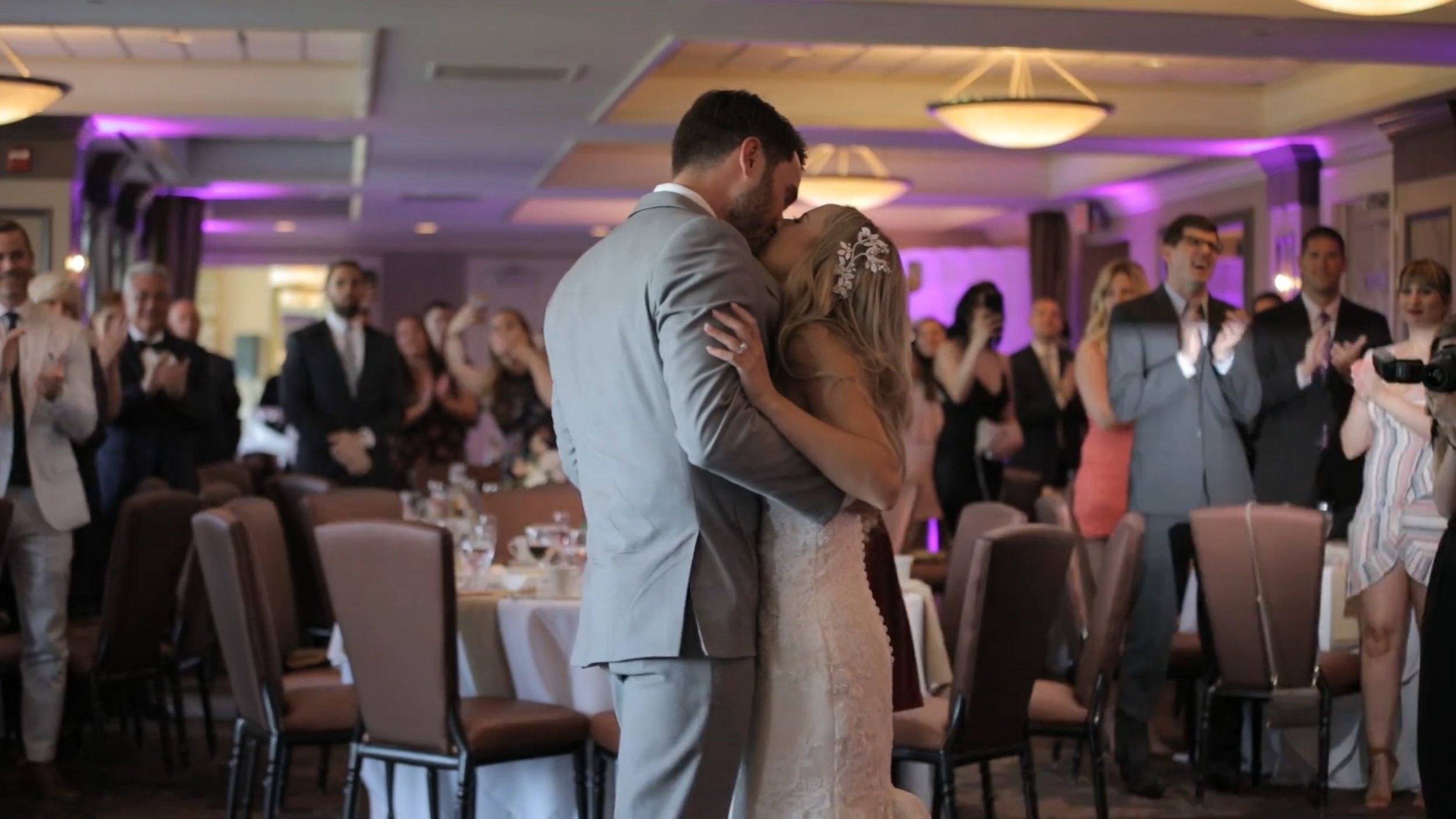 Bride and groom kiss during their first dance.