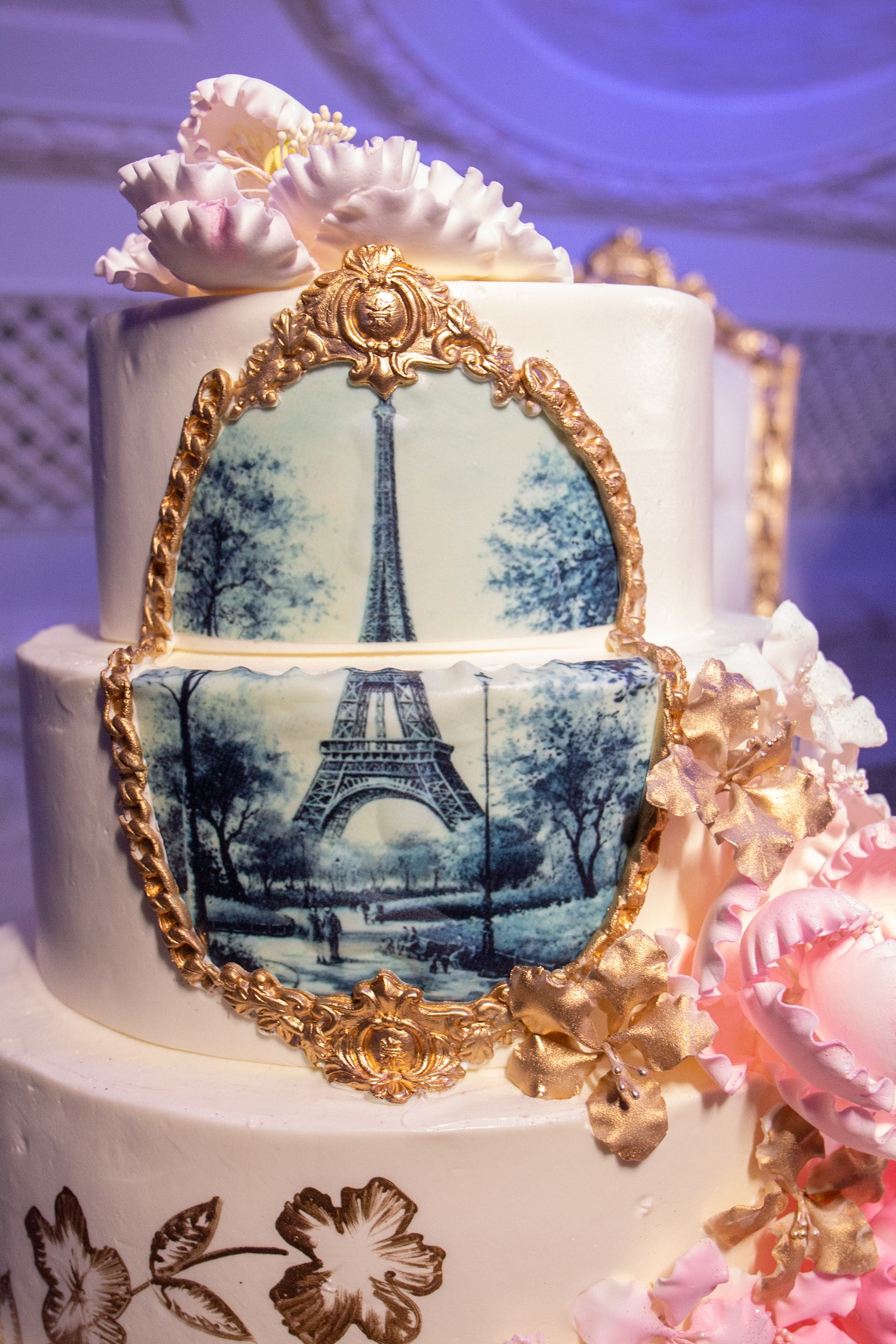 Wedding cake designed with a black and white portrait of the Eiffel Tower.