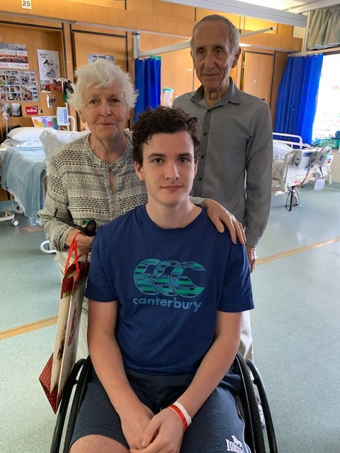 Conor with his grandparent David and Joan on his last day at the PA Spinal Unit