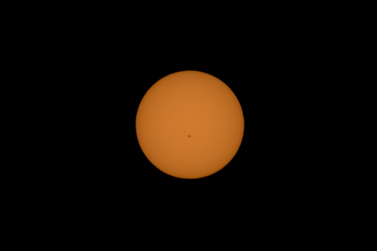 Photo of sun taken with solar filter attachment