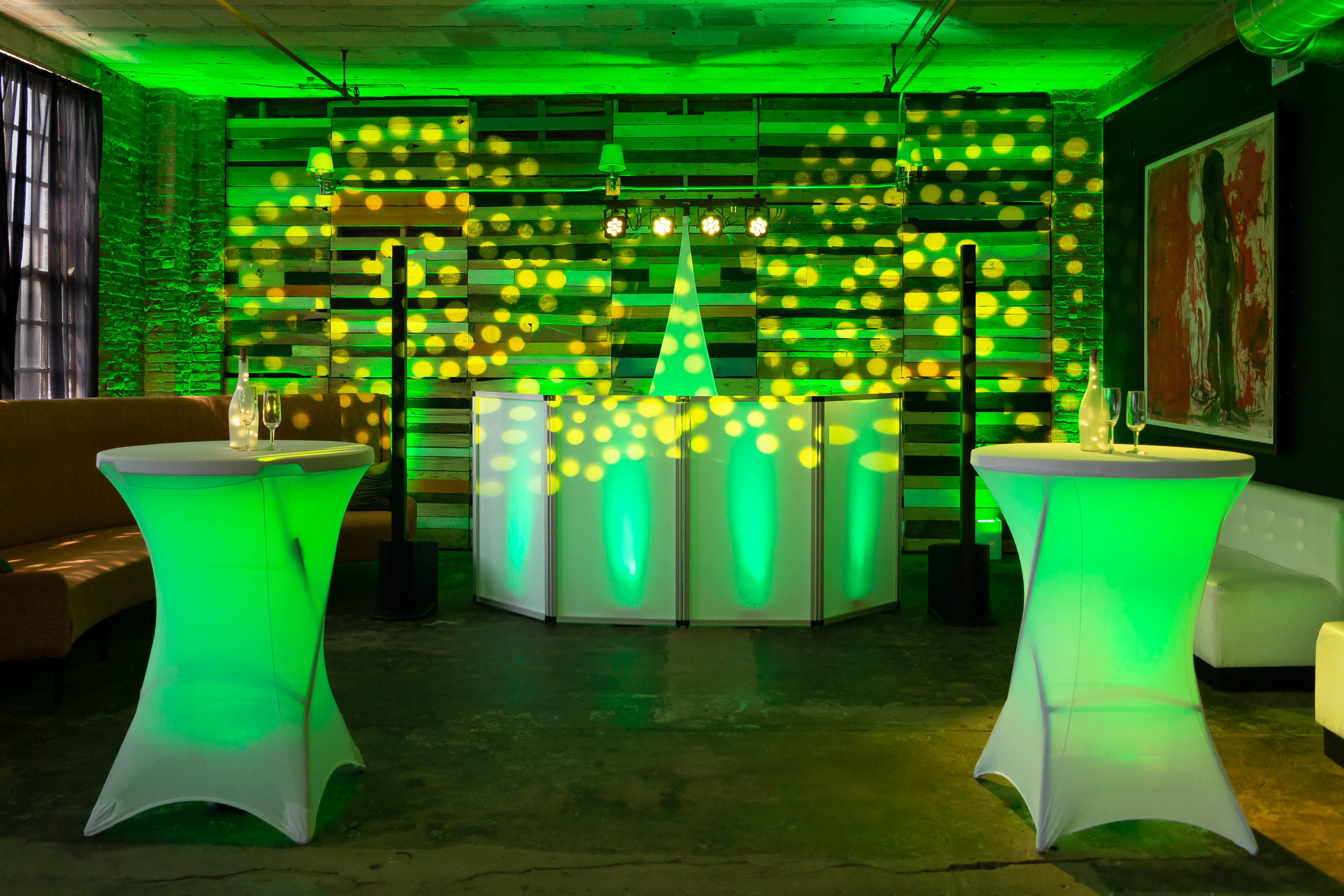Uplight color wash with pinspot lights, LED cocktail tables, and gobos will transform any event.