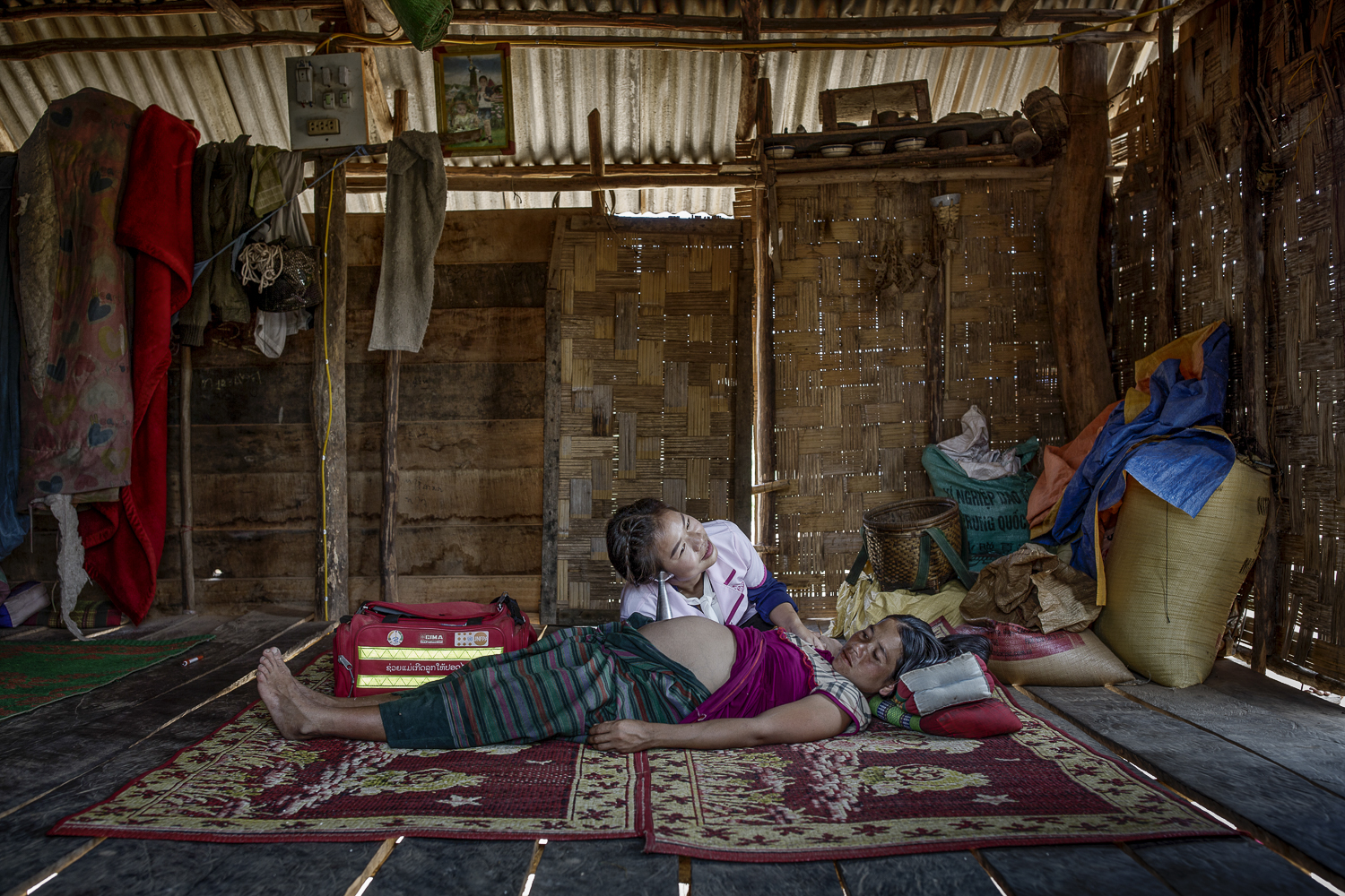 Midwife at home visit in rural Laos- 2017