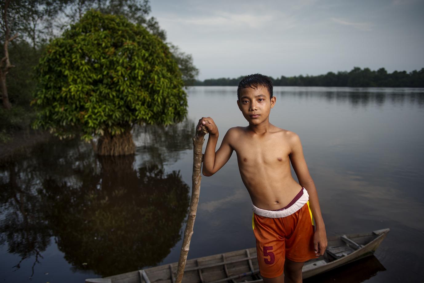 Boy at Siak river, Sumatra / Indonesia