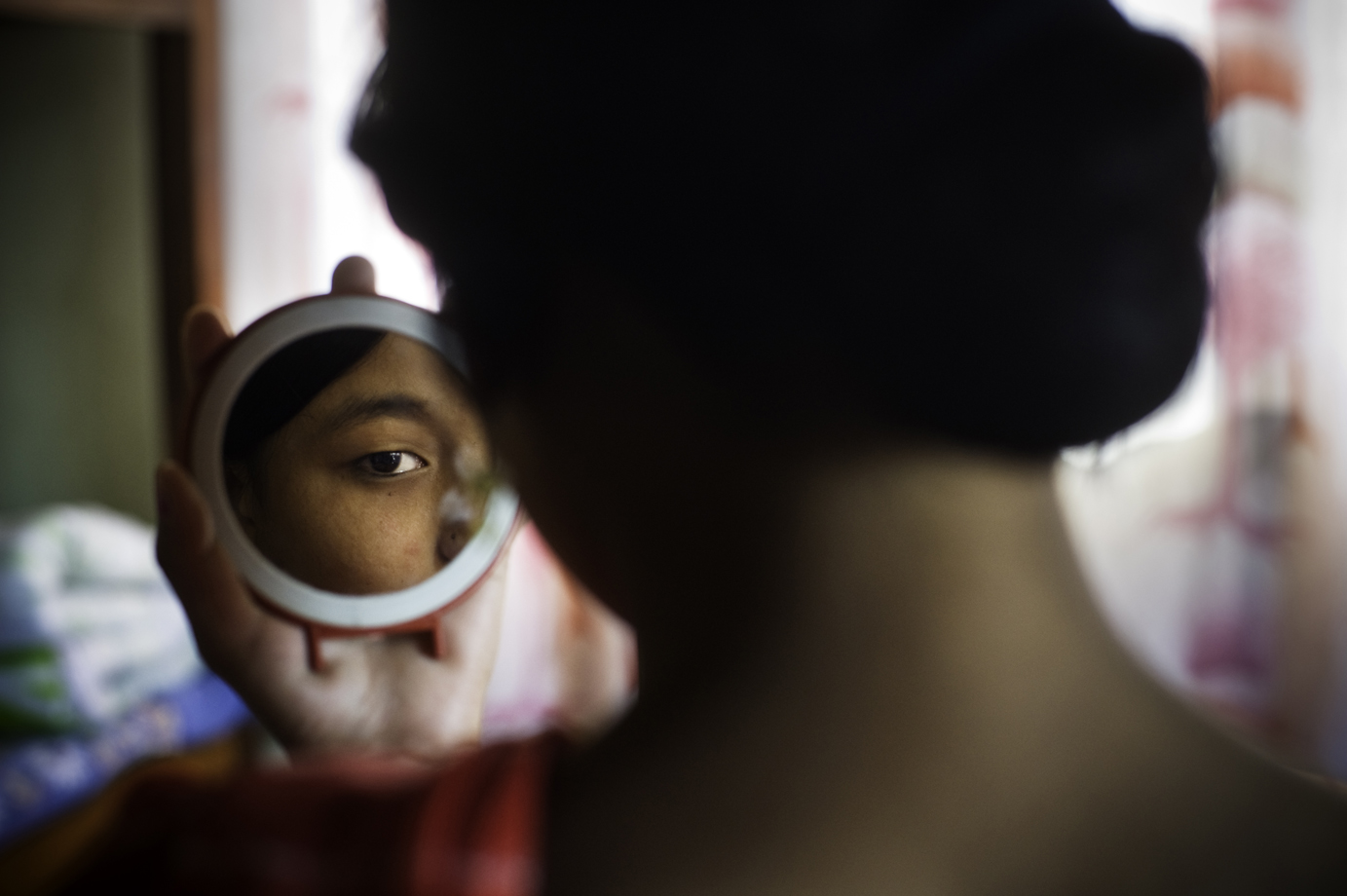 A female human trafficker survivor at a at a sheltered accommodation at the Nepalese border with India, Terai region / Nepal