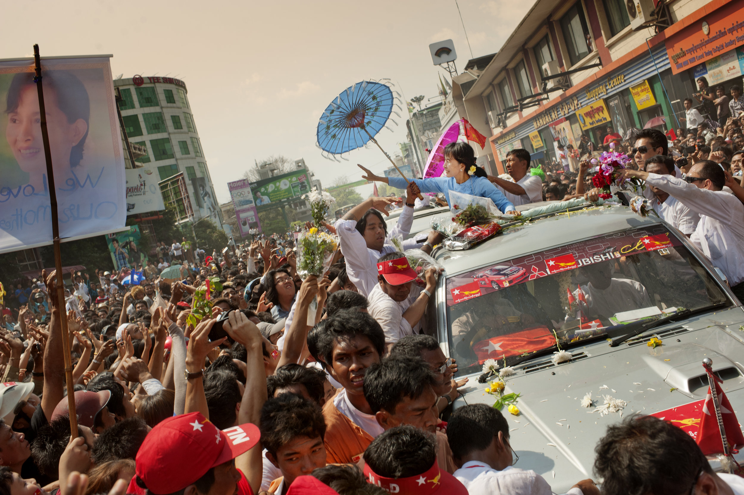 Aung San Suu Kyi, is greeted on the streets of Mandalay for the upcoming parliamentary seats election / Burma - 2012