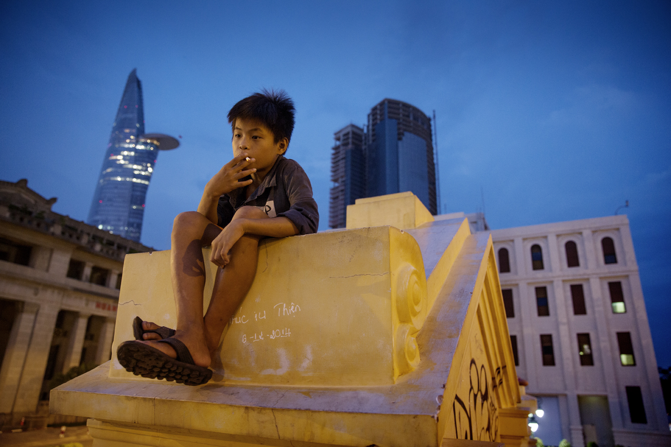 Street child smoking a cigarette, Saigon / Vietnam - 2015
