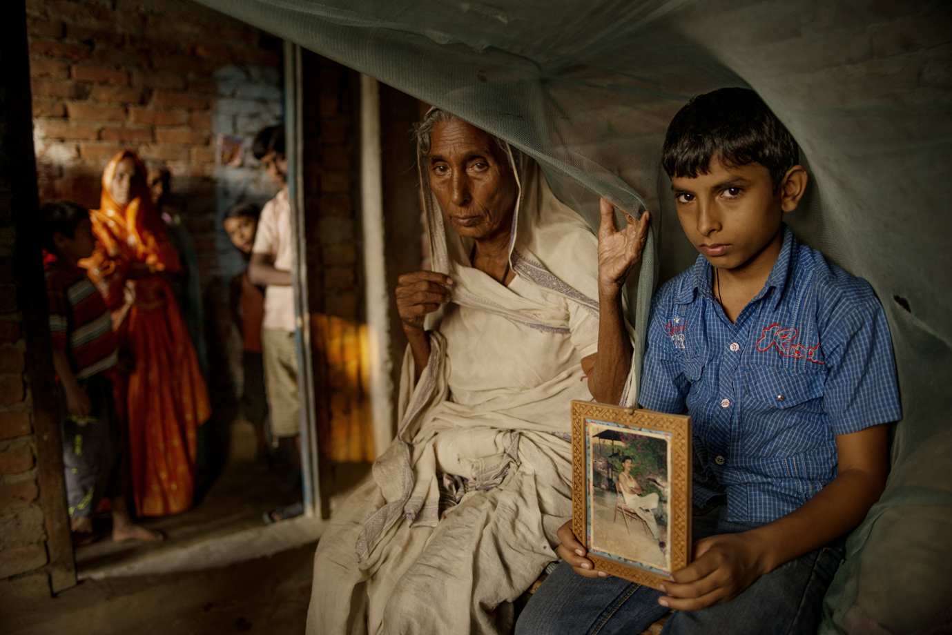 A mother and a son, of a man who lost his life in Qatar when he worked as a construction worker at a football stadium for the fifa world cup. The ITUC predicts that there will be at least 4000 worker fatalities by the time the 2022 FIFA World Cup begins. / Nepal
