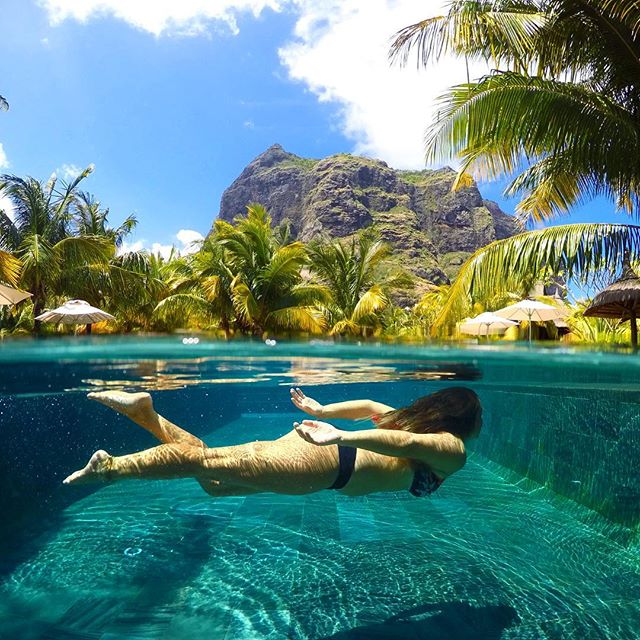 Swimming under palm trees 🌴 🧜🏽♀️ Miss this place #mauritius