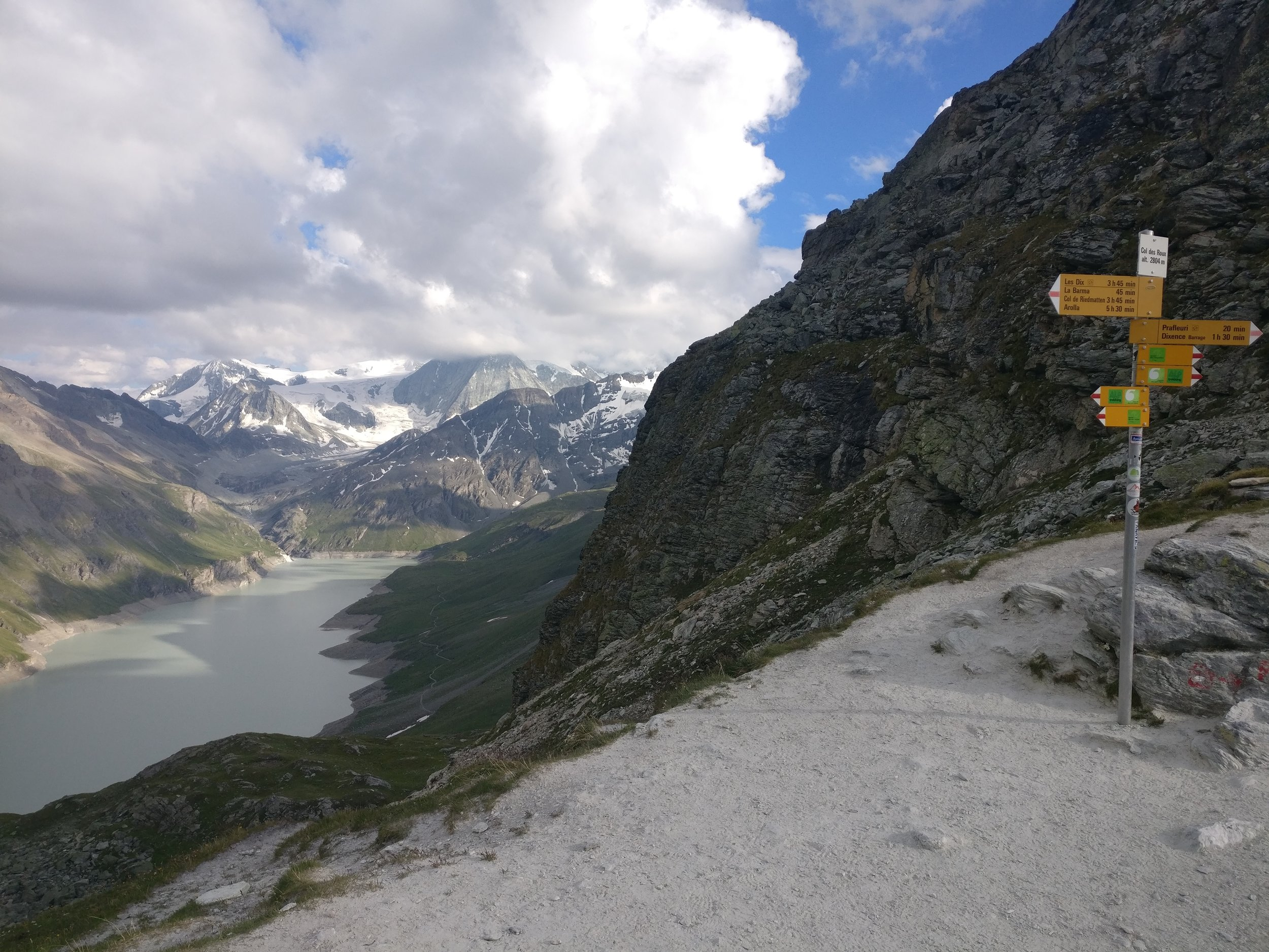 Standing at Col Des Roux looking down at the trail beside Lac Des Dix you follow before ascending at the far end.