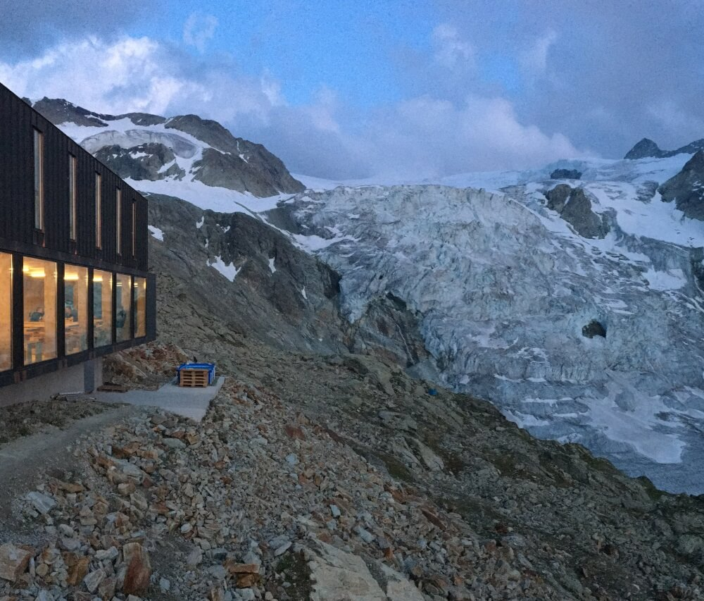 Cabane de Moiry has a dining room with a glass facade that allows guests to enjoy views of Glacier de Moiry throughout their stay