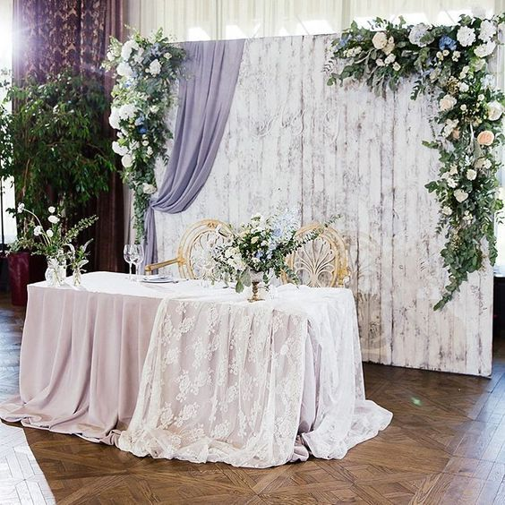 Pastel Purple & Lace - Whimsical wildflowers in vases, long draping of solid & lace, backdrop with texture prints & draping flowers.