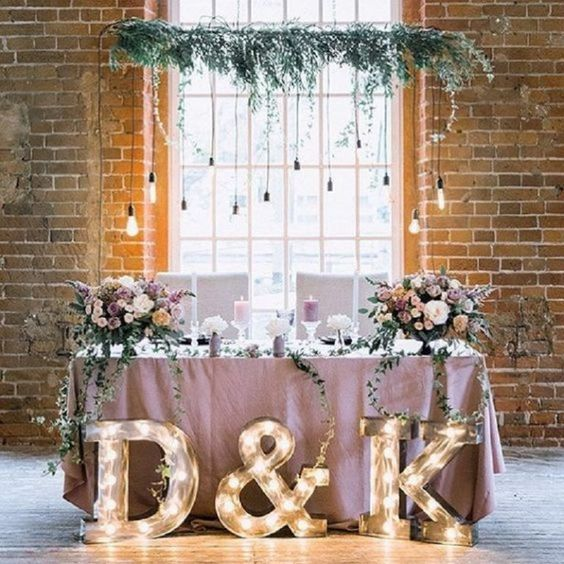 Boho-chic & Light-up Initials - Pastel table cloth, soft white chairs, initial lights, and vines mixed with purple & pinks.