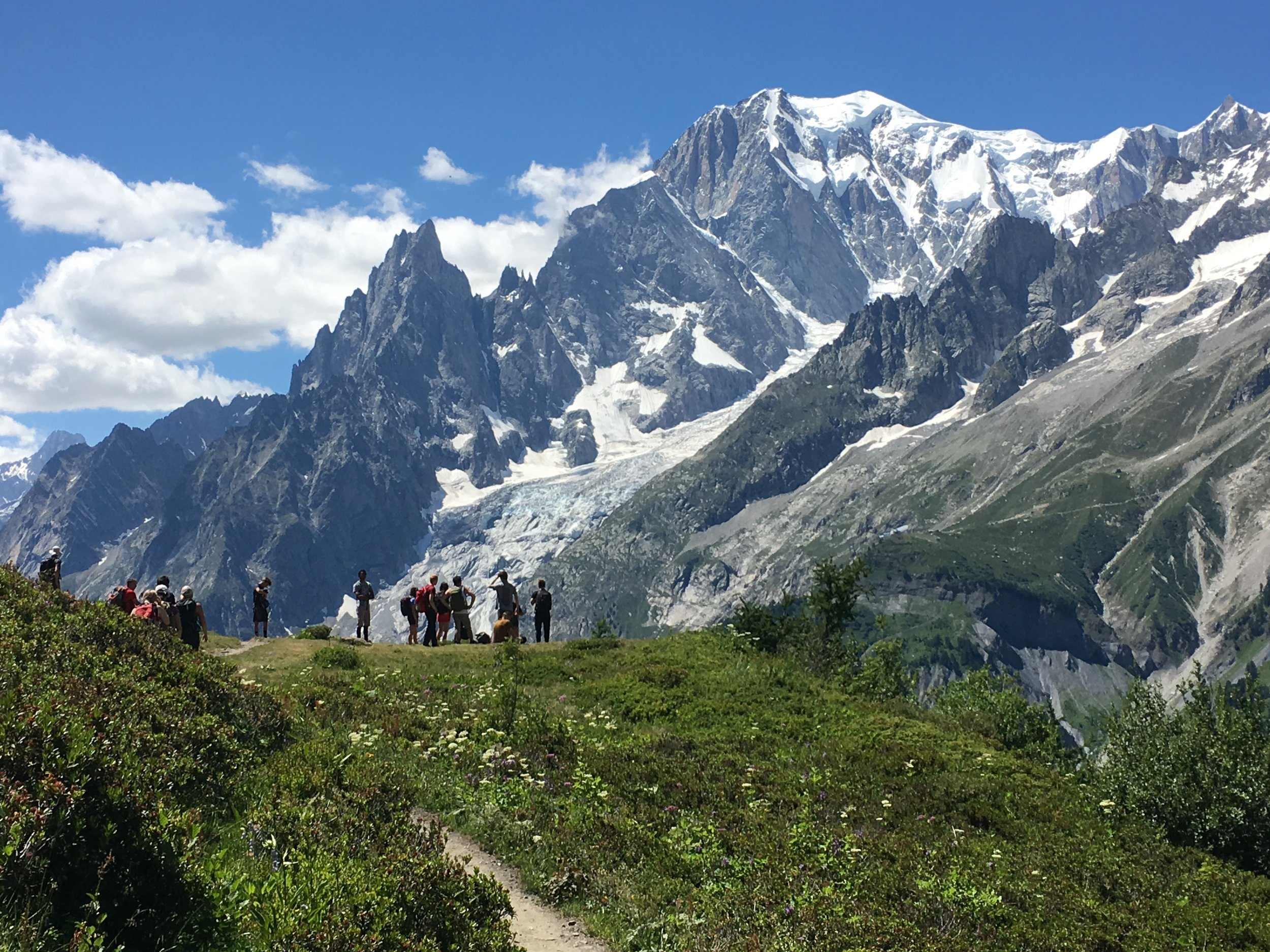 Students hiking above the Mount. Blanc valley on the Tour du Mount Blanc trail.