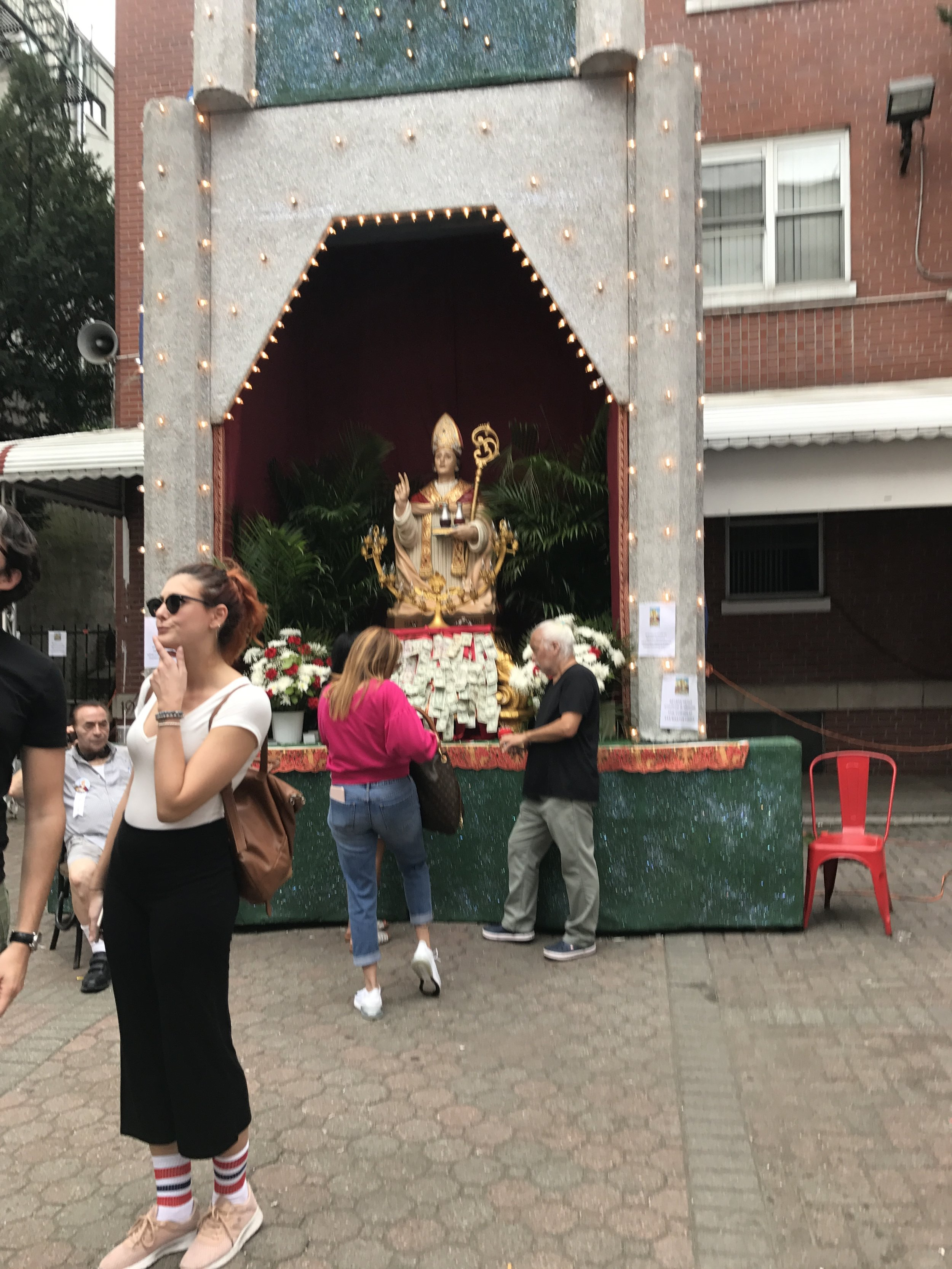 San Gennaro himself with offerings of money