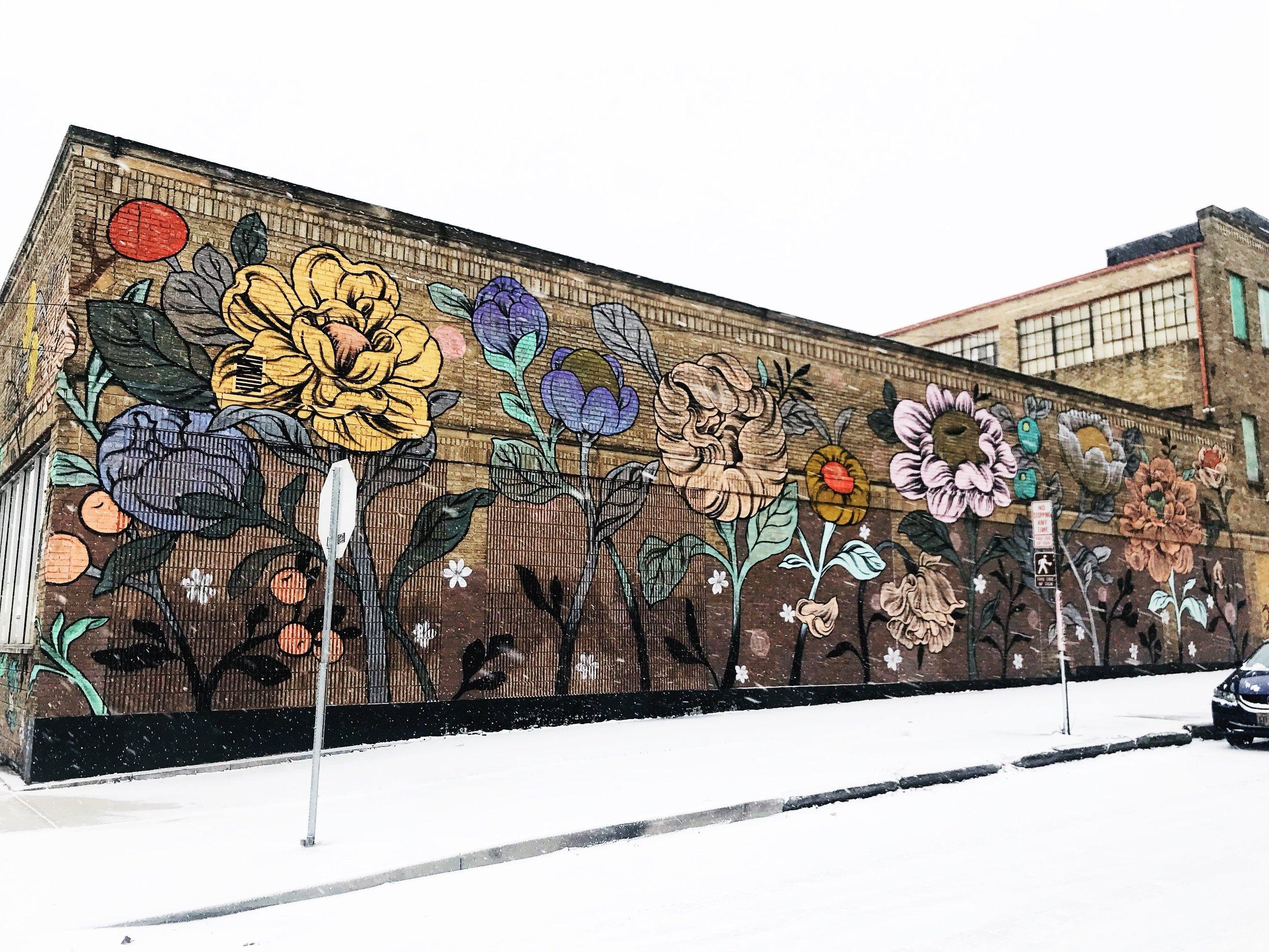 Mural by Ouizi on the side of Handmade Toledo's building. Photo credit Elizabeth Rogers Drouillard.