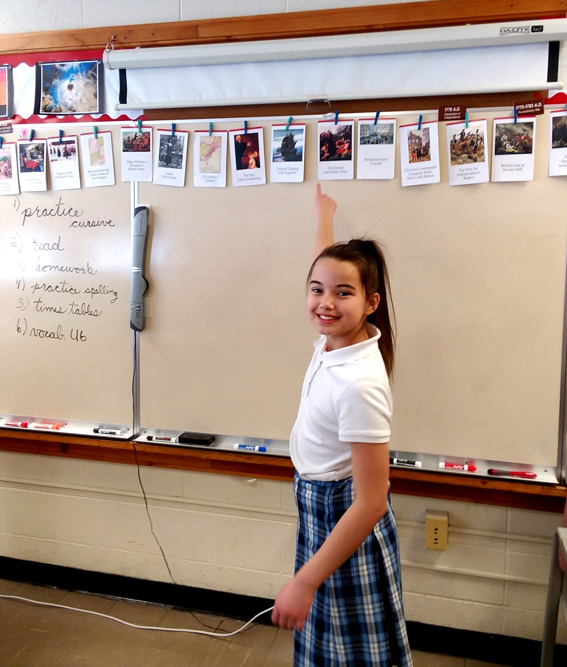 - A fifth-grader shows off a timeline of American history.
