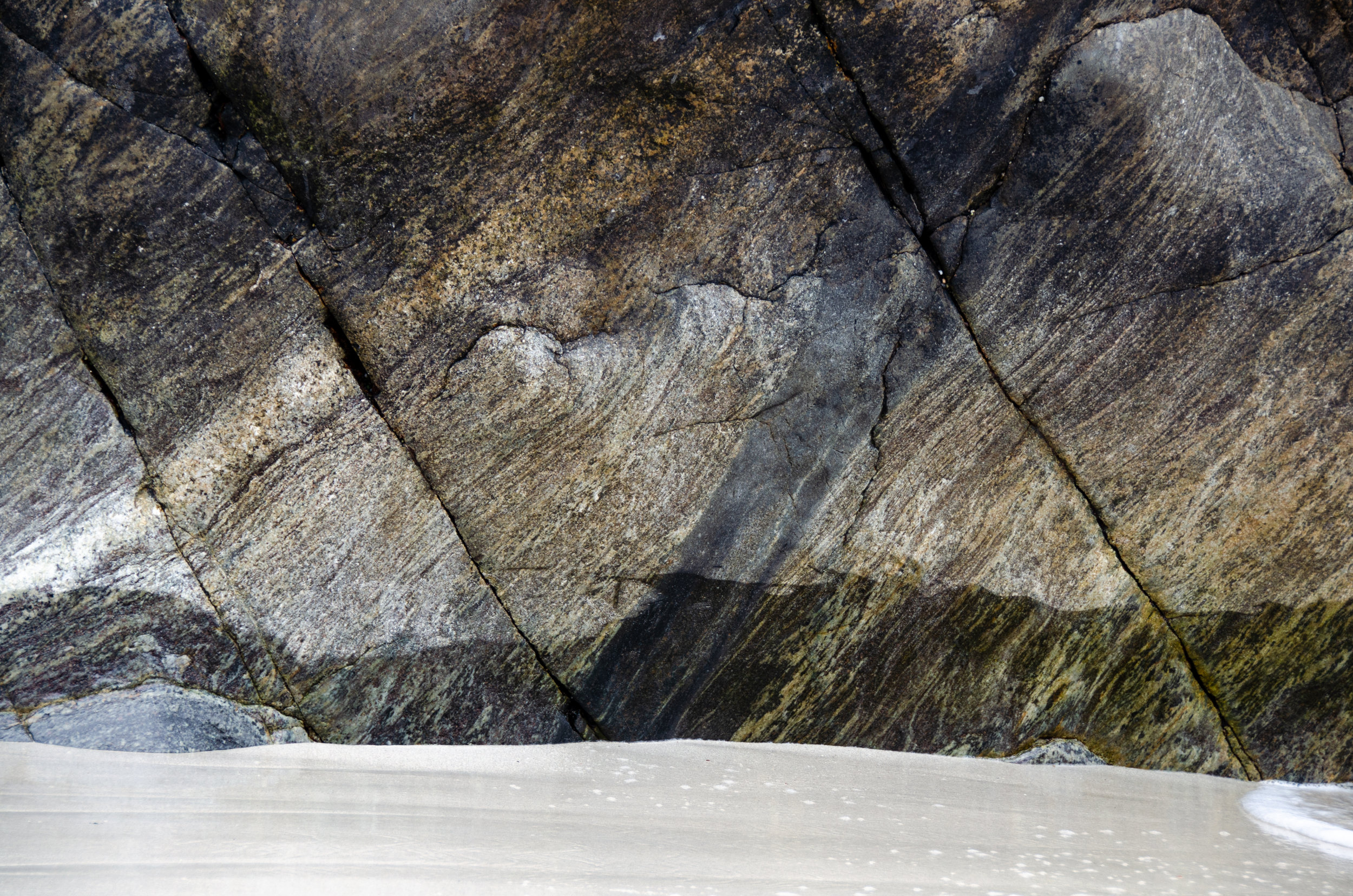 the stark and sharp lines of Gneiss rock slabs