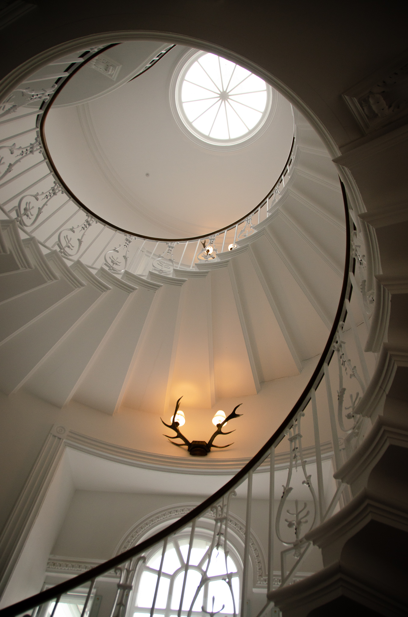 the impressive staircase leading up to the guest rooms in the house.