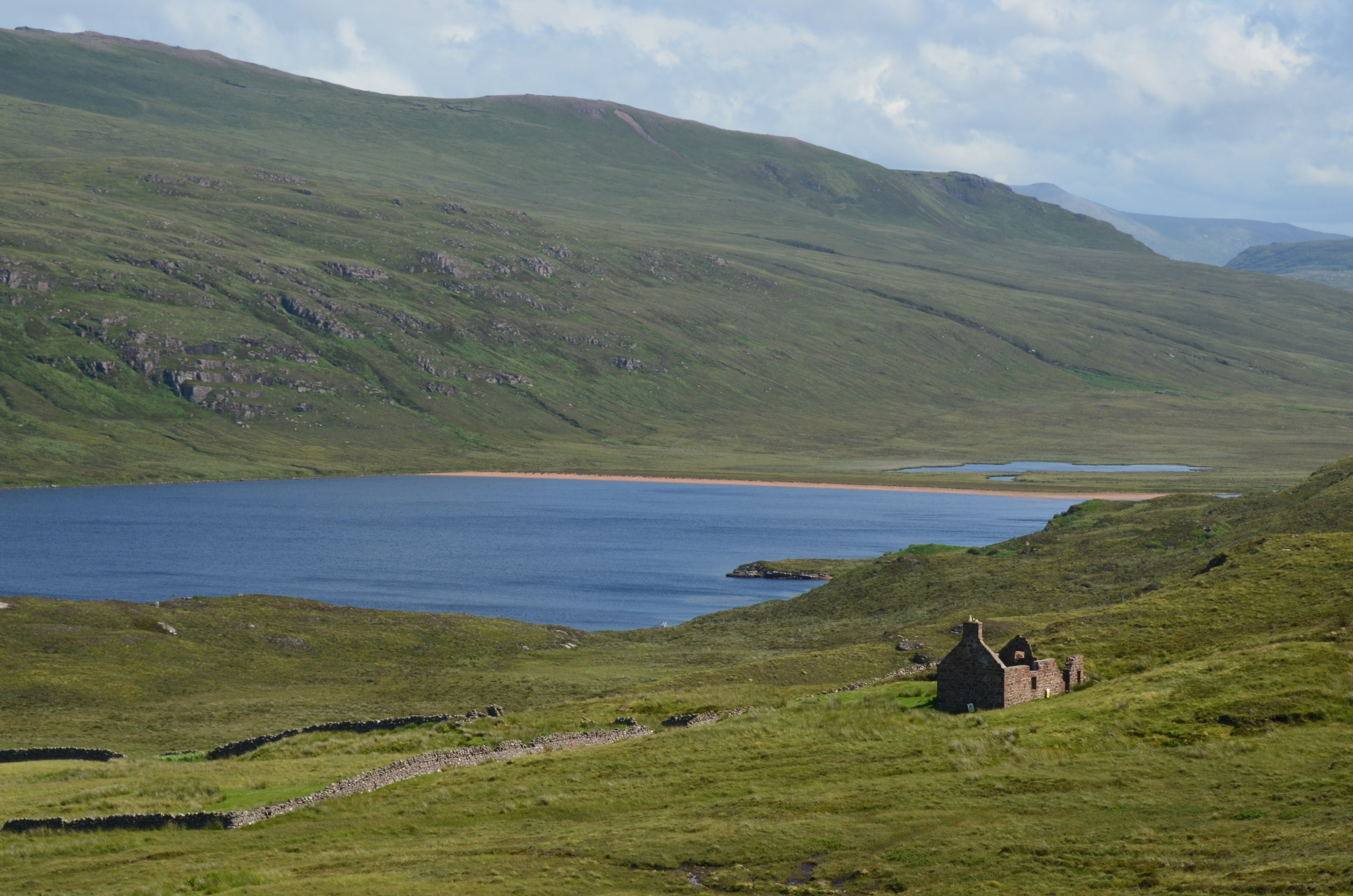 the abandoned house which hugs the shores of Sandwood Loch- a freshwater loch