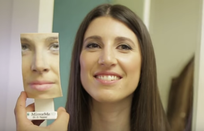 Emily, post-surgery, next to her 3D facial model. (   Source   )