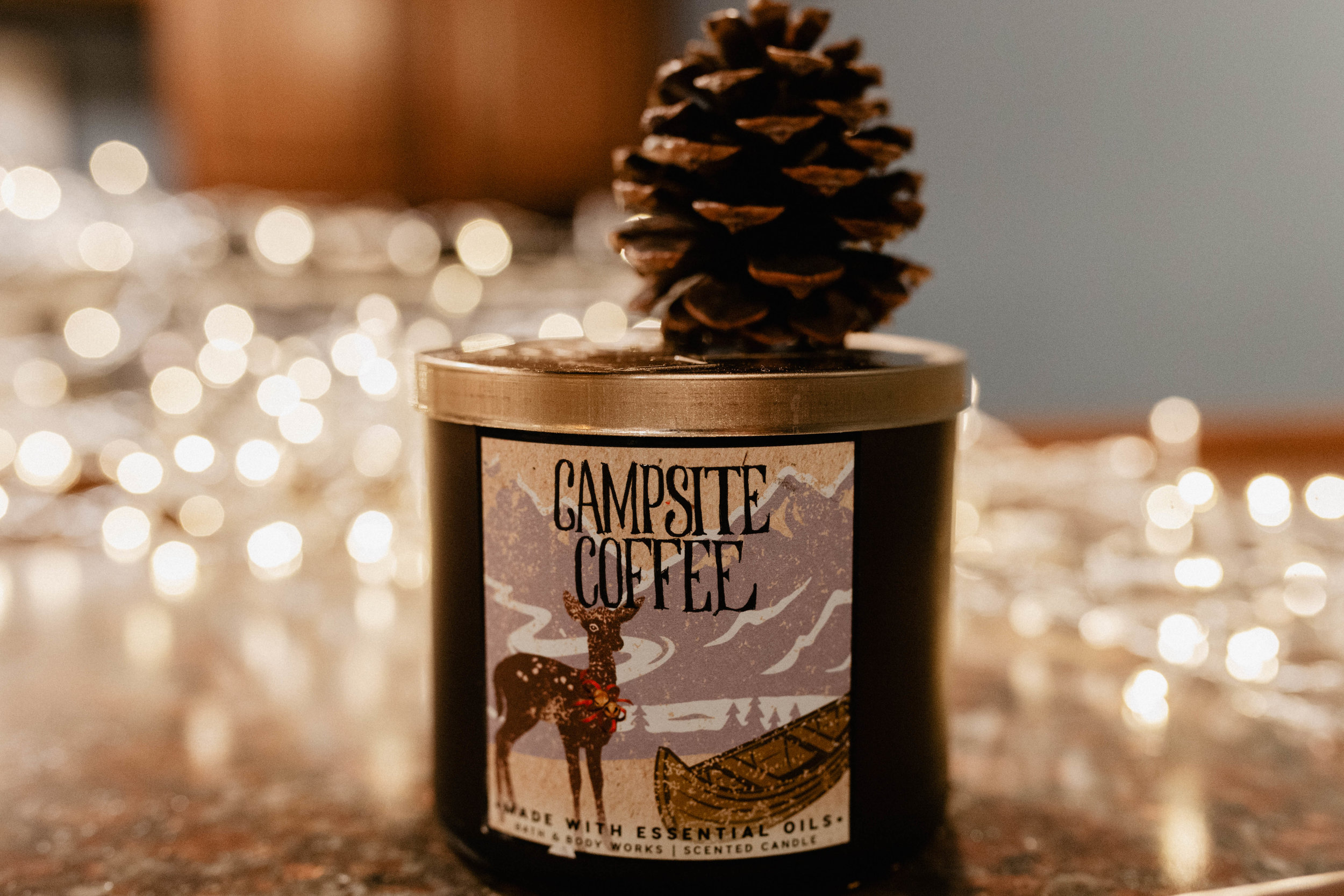 """CAMPSIDE COFFEE - Campsie AND coffee?? I'll take twenty. I loved the Marshmallow Fireside candle from Bath and Body Works, so when I saw coffee combined with similar scents, I HAD to grab this one too. Usually I stay away from coffee (and chocolate) """"scents"""" because they typically smell extremely fake and it's never the same. I decided to give this one a go and I'm SO glad I did. It's delicious smelling (with vanilla scents). Seriously smells like you are brewing coffee over a campfire."""
