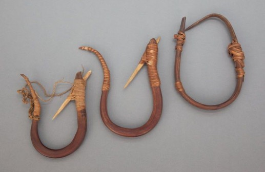 Fish Hook - Though fishing was also often performed with spears and nets, the fish hook was a quick and easily crafted method of fishing year round. A tiny piece of wood is carved into a hook and anchored to a small heavy object, like a stone or bone. The string was traditionally made of vines.