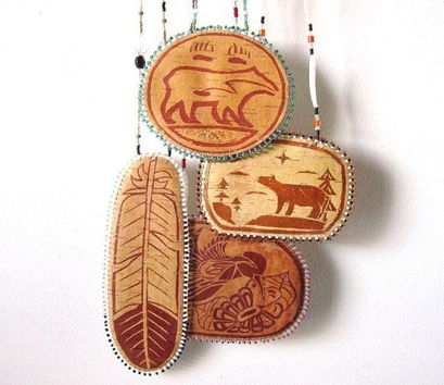 Birch bark pictures - Pictures and art carved from birch bark was common in Algonquin bands. We would adorn everything from teepees to baskets to canoes with artistic portraits. The pictures would often be markers of Clan or Band membership, but they would usually be crafted for decorative purposes.