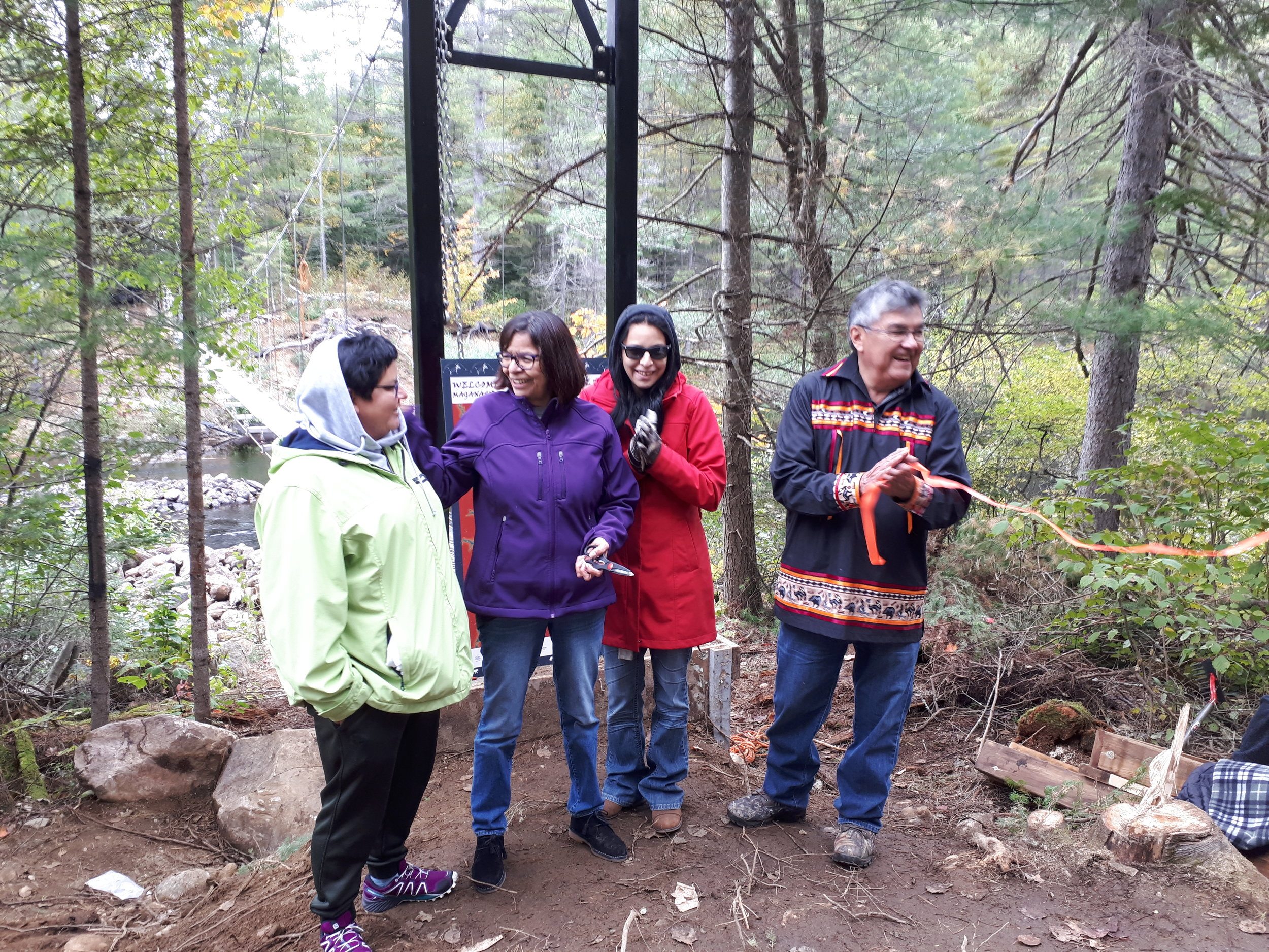 Mandy Perrier, Rosanne Young, Miranda Perrier and Chief St Denis at the Grand Opening of the Wolf River and Tommy John Trails in Maganasbi Protected Area September 2018.