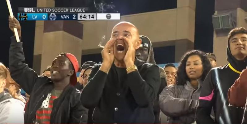Las-Vegas-Lights-coach-Chelis-smokes-in-the-stands.jpg