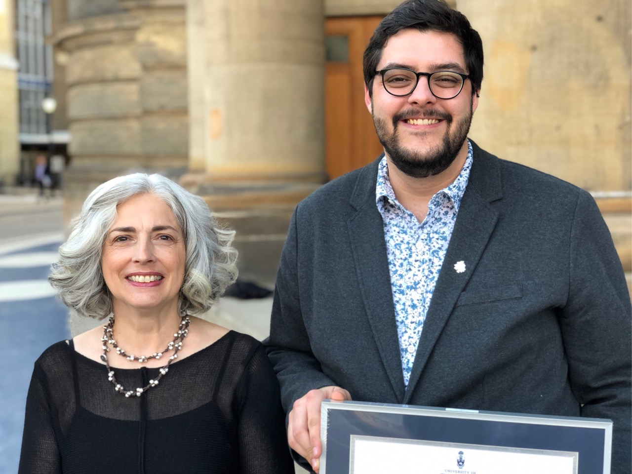 Prof. Jodie Jenkinson and MScBMC student Alex Young outside Convocation Hall on April 22, 2019.