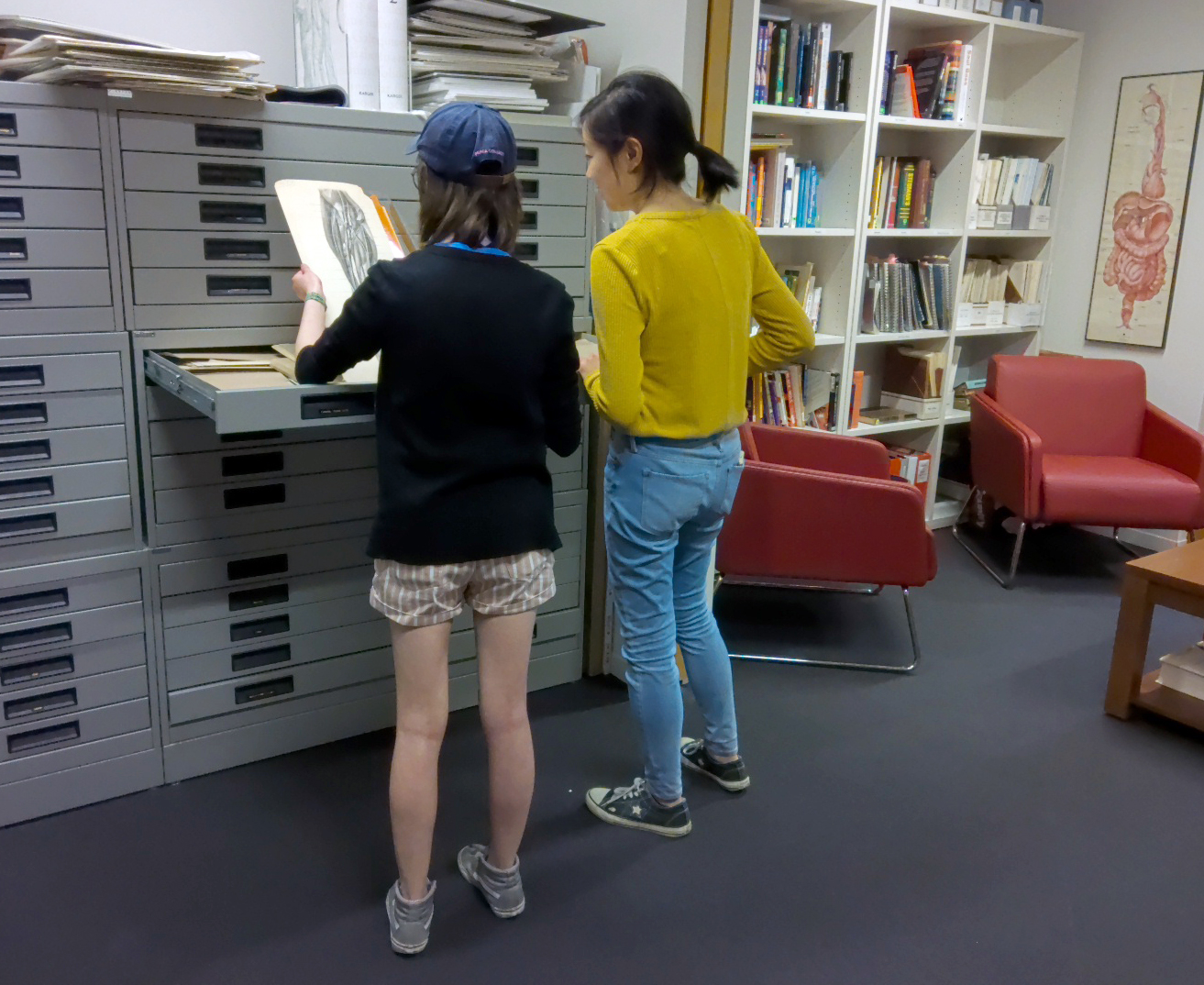 BMC students Colleen Tang Poy and Jenny Chin look through archival material in the Elizabeth Blackstock Library.