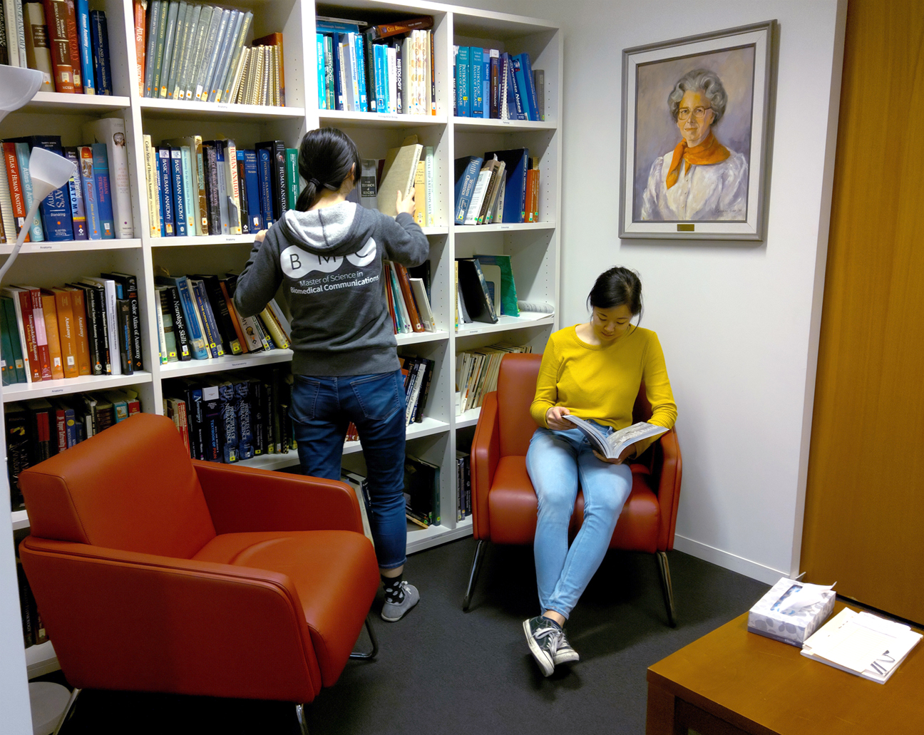 BMC students Amy Cao and Jenny Chin looking for reference material in the Elizabeth Blackstock Library.