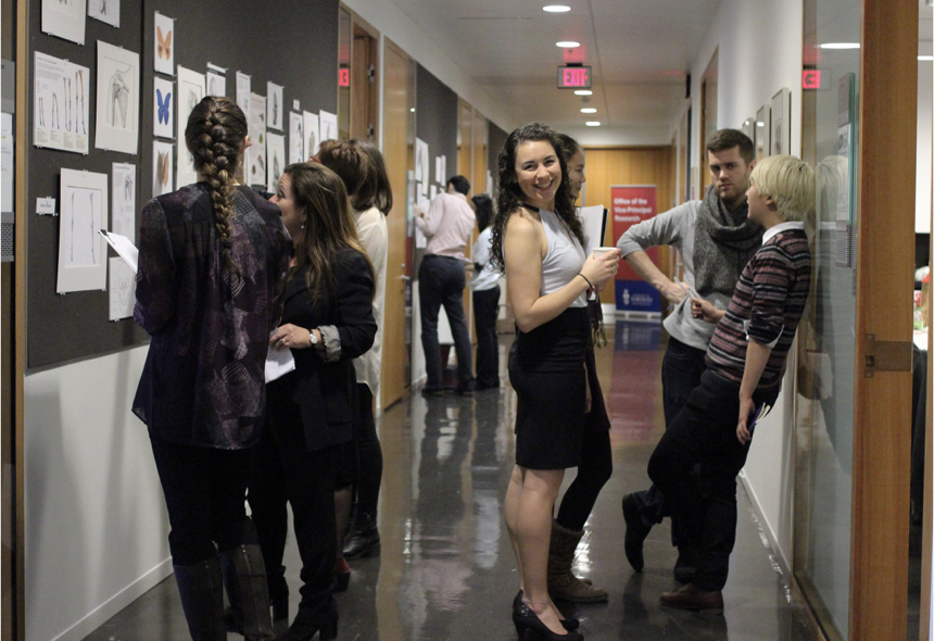Students and faculty congregate in the main BMC corridor during our semi-annual critique.