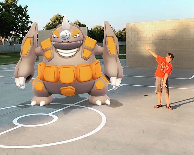 We found a basketball court with a #pokeball painted on it. So naturally, tada! #pokemongo #dadstuff