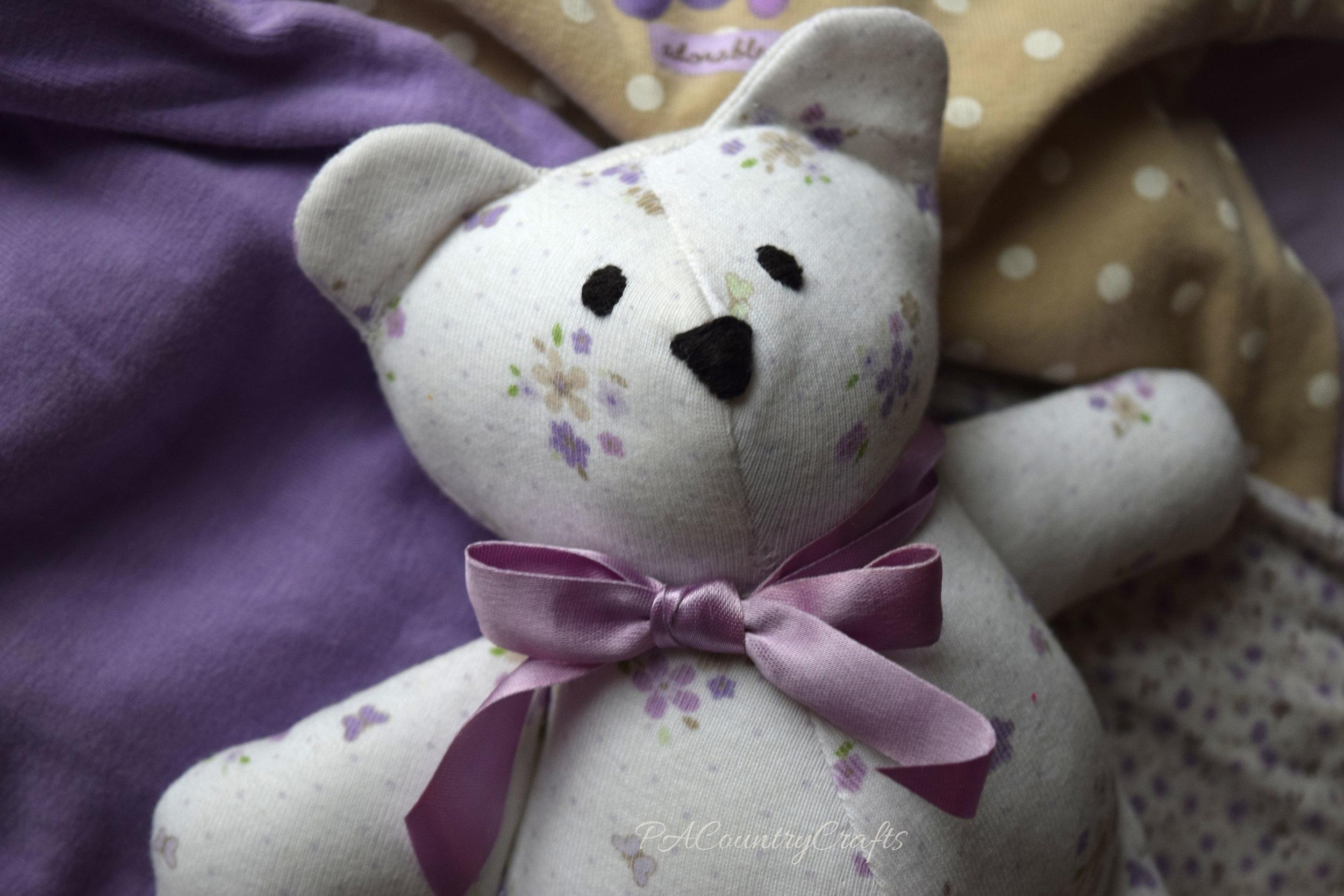 Make a cute stuffed bear from an old baby onesie.