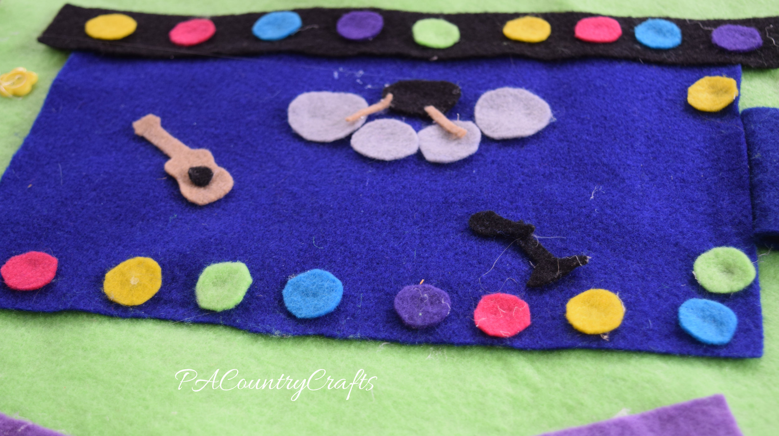 Felt stage and instruments glued to a no-sew felt playmat