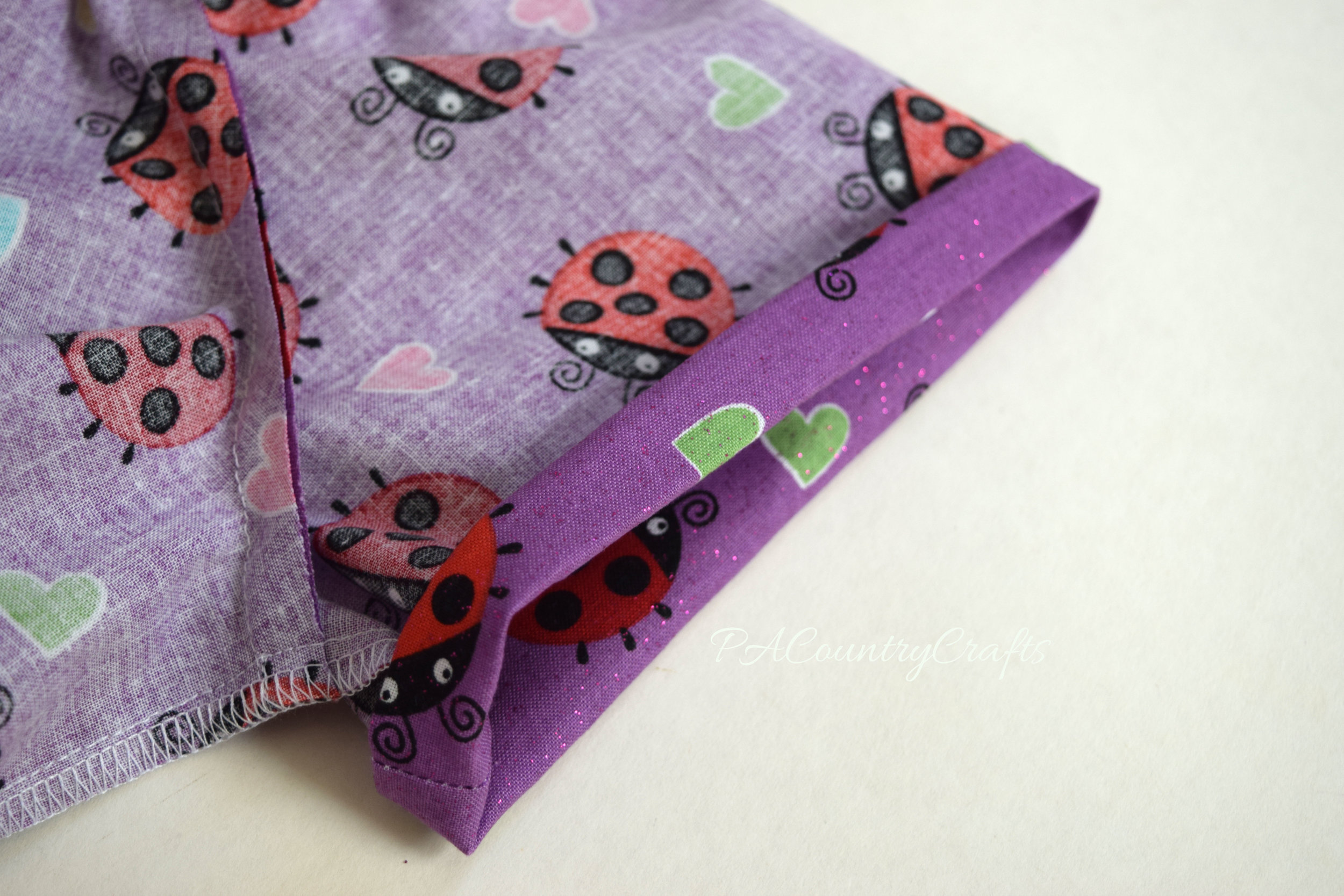 Fold under to sew casings for elastic on sleeves