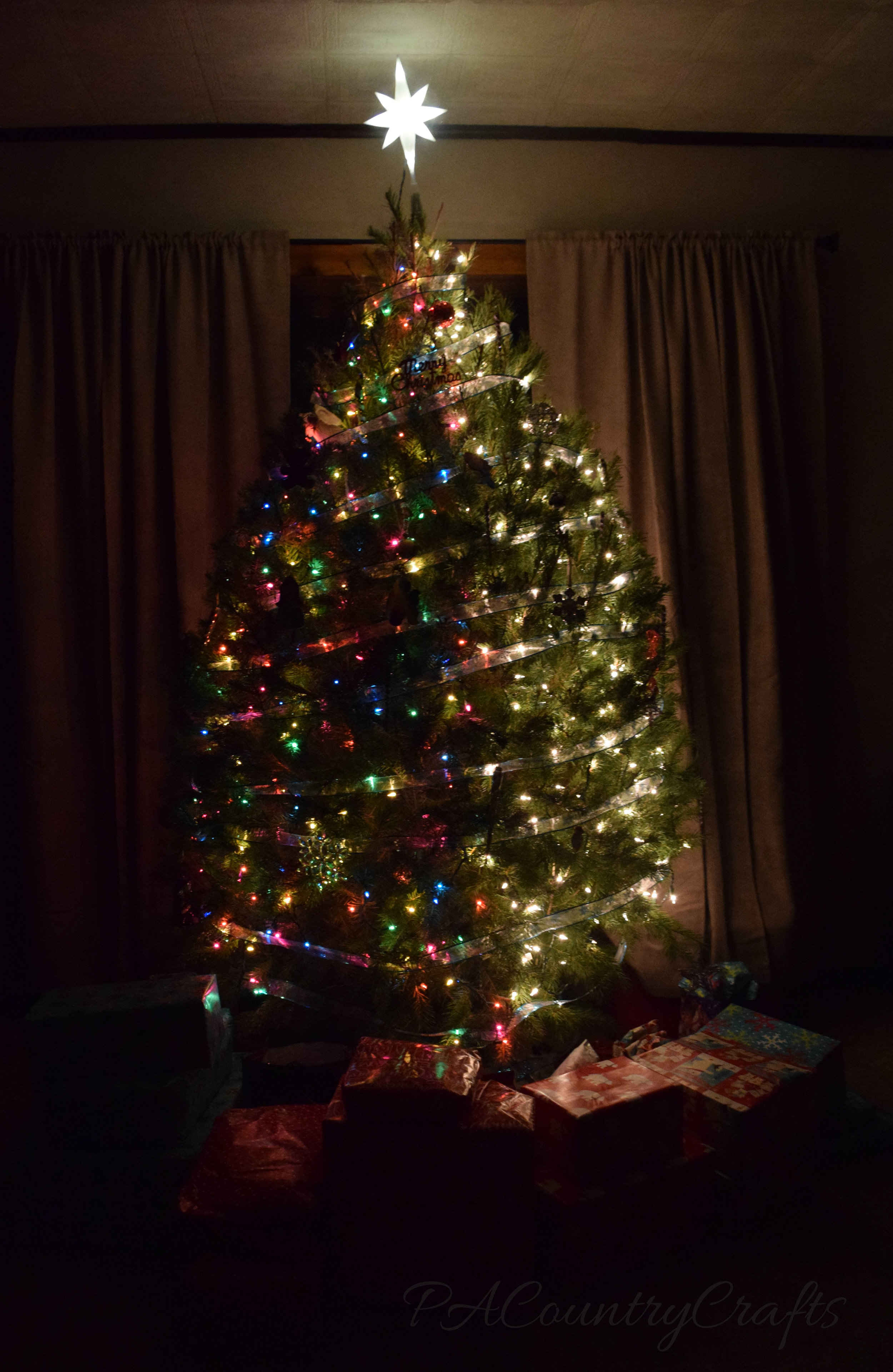 half colored lights and half white lights on the tree