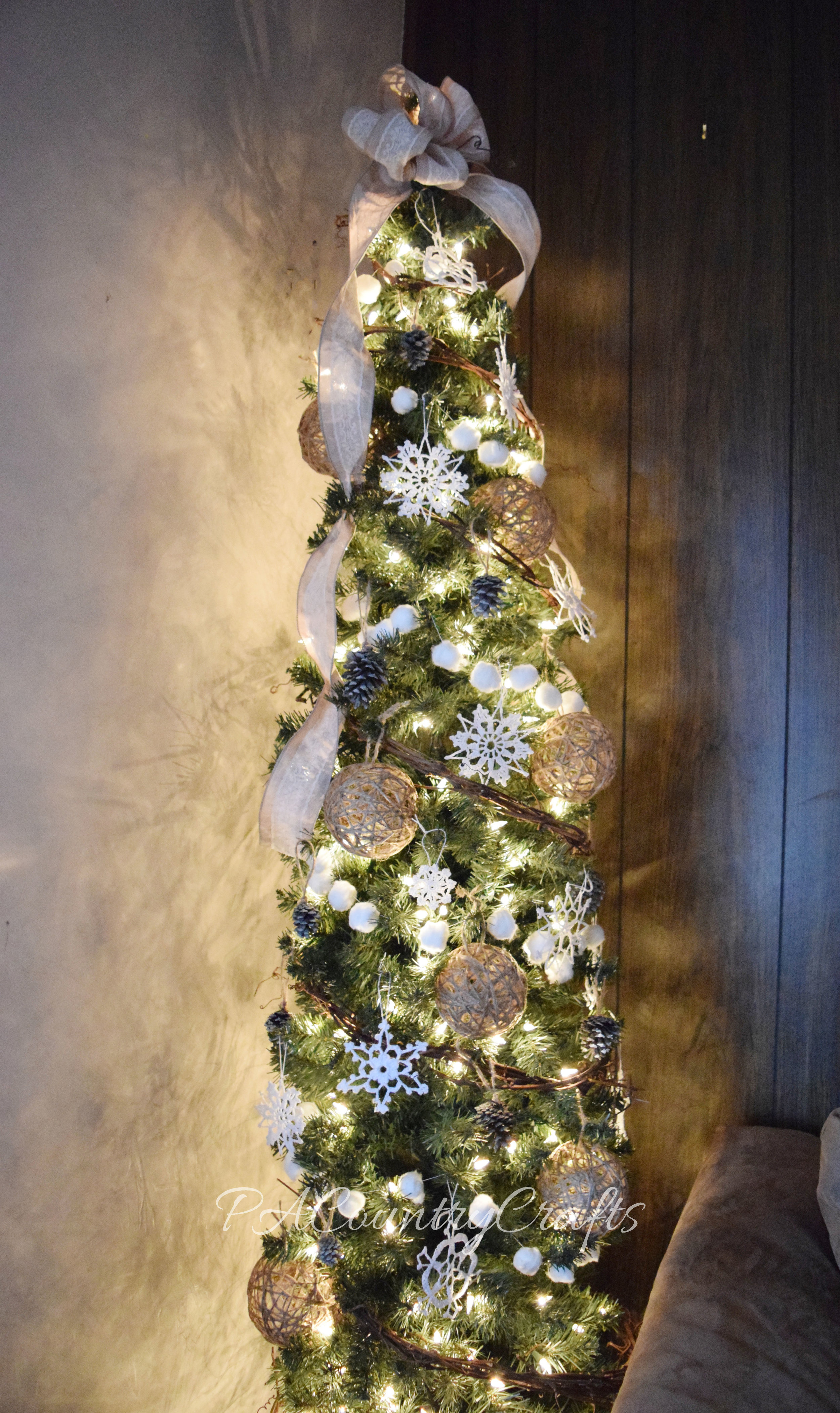 A DIY rustic, winter tree with homemade decorations...