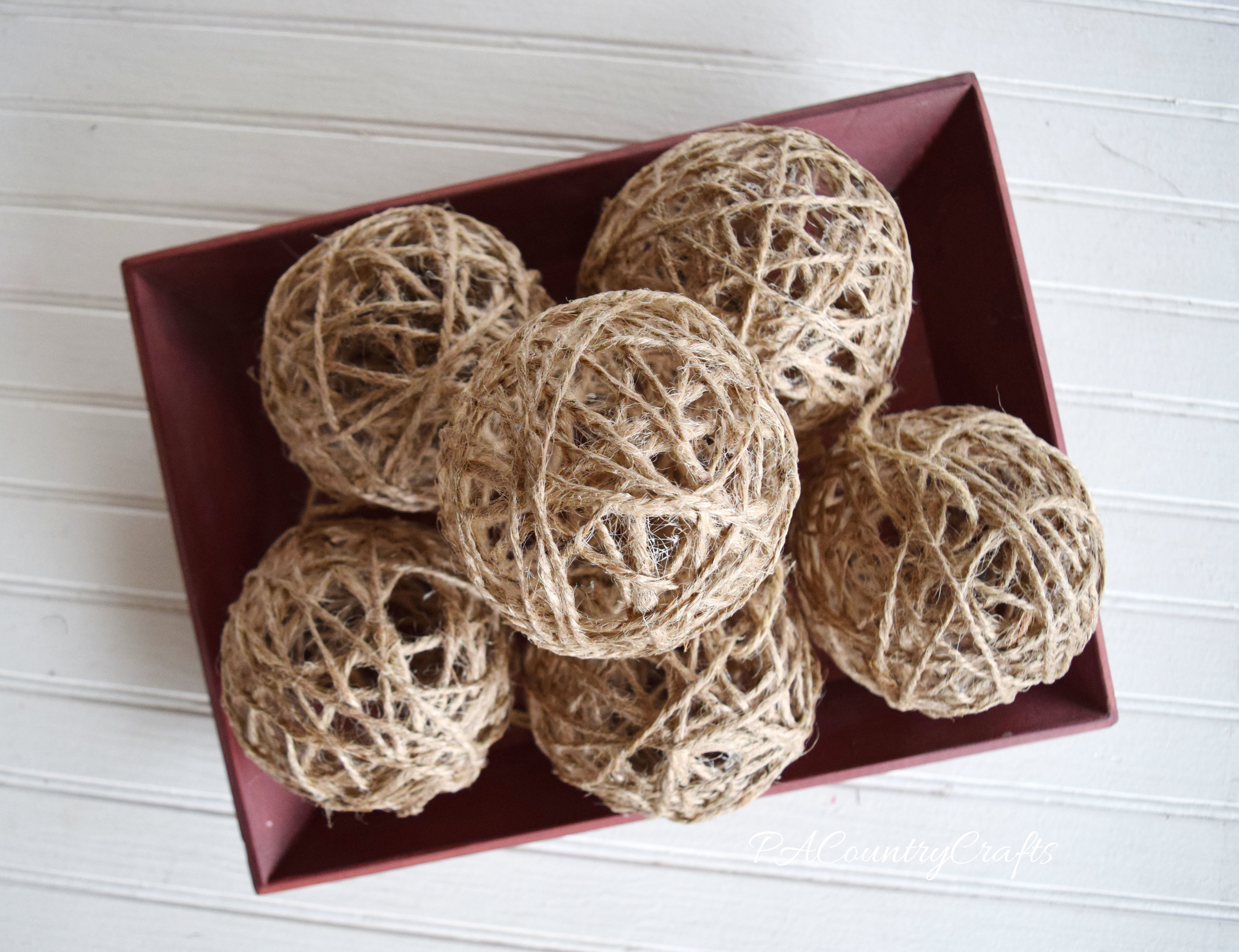 DIY twine balls made with jute, balloons, and glue!