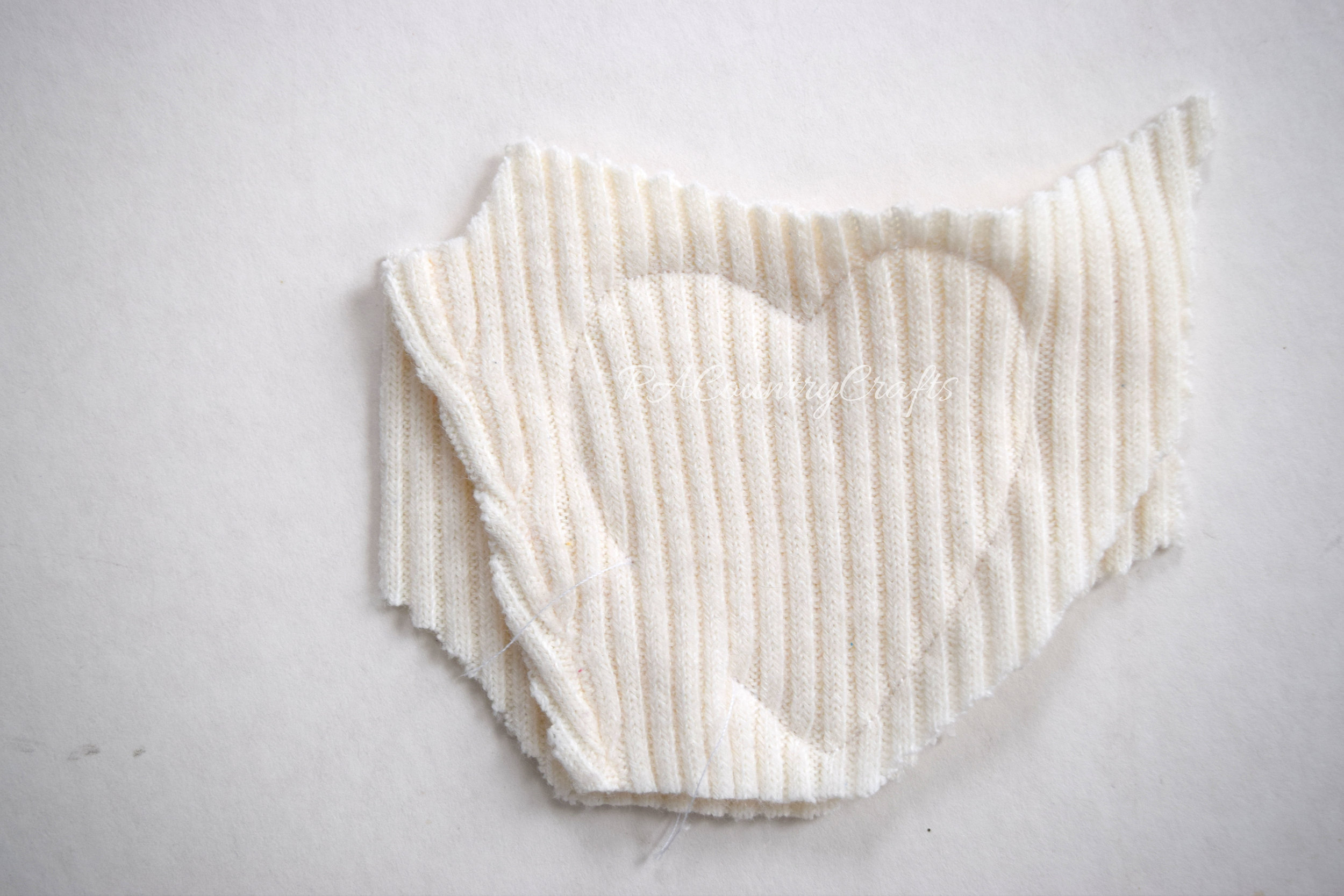 Sew hand warmers from old sweaters