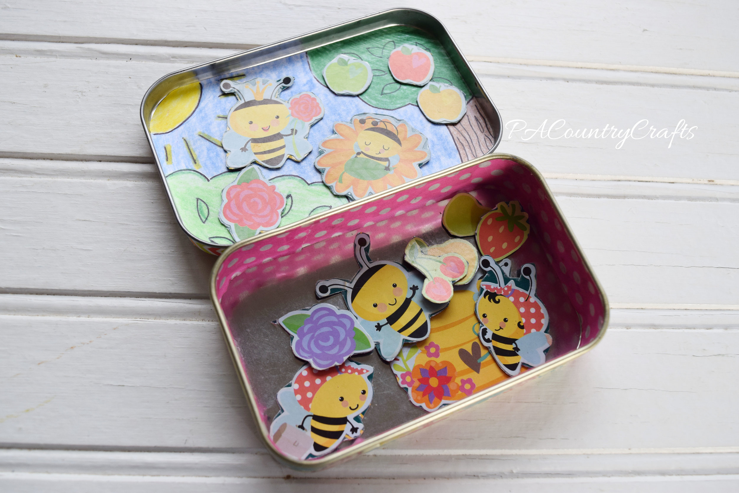 Use sticker sets, free magnets, and old mint tins to make a playset for the kids!