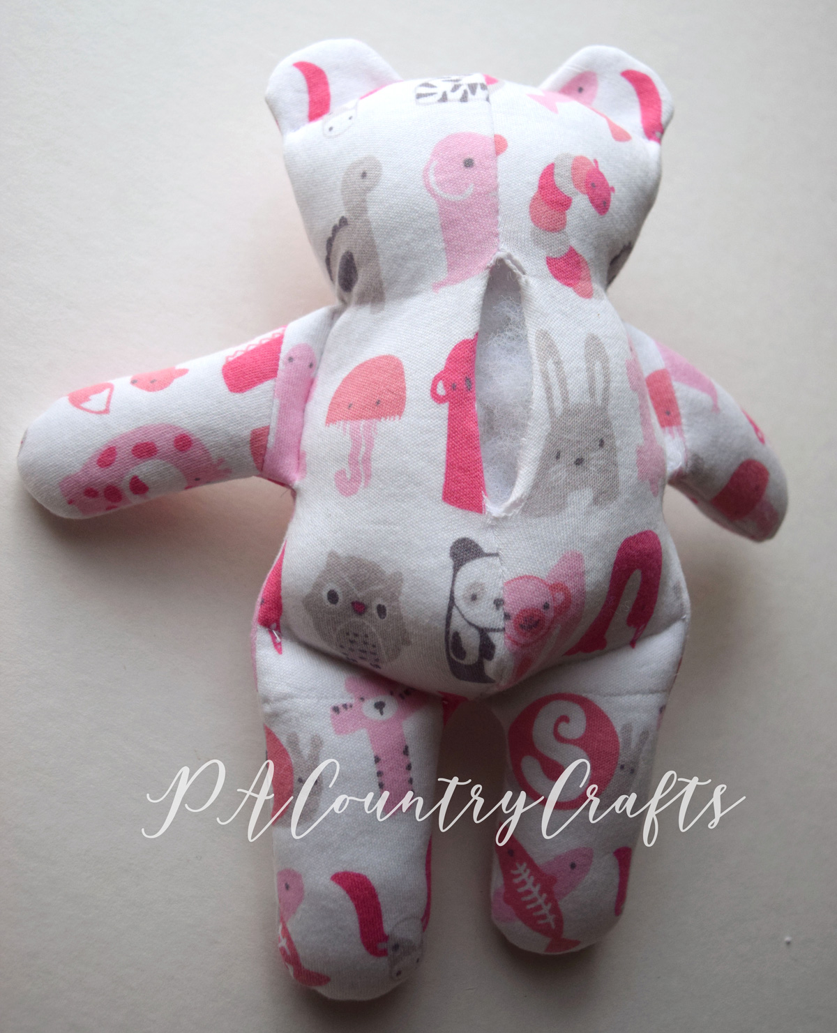 make an easy stuffed bear from old baby clothes