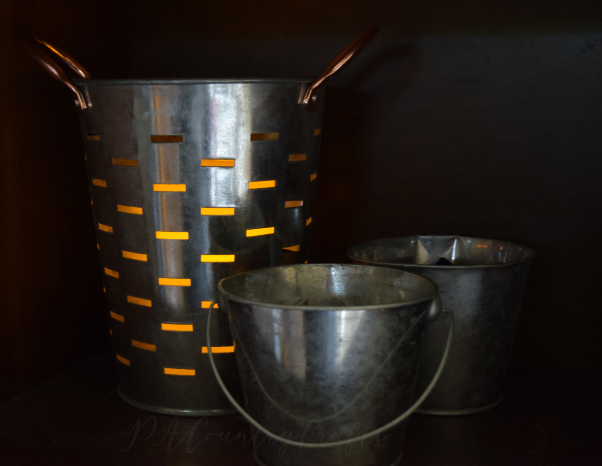 olive bucket with candle