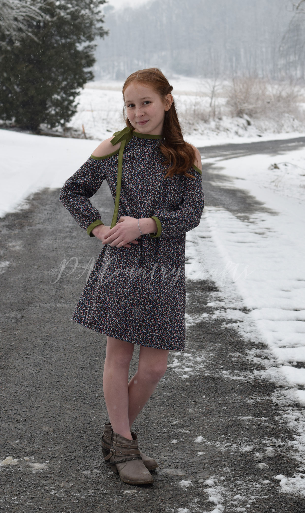 Retro style girls dress with a 70s silhouette and cut out shoulders